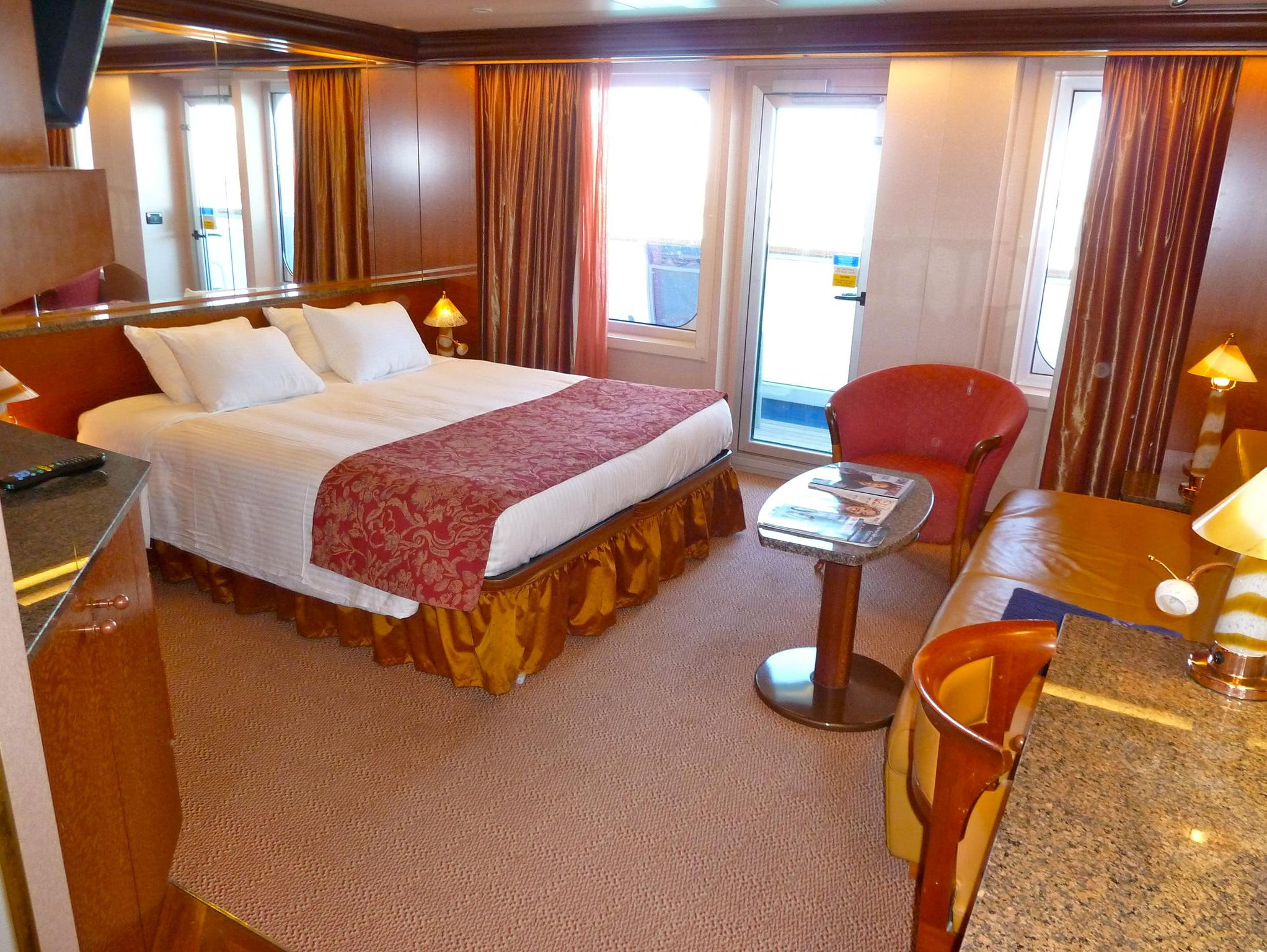 Thirty-two Ocean Suites on Deck 7 are similar to Junior Suites but have darker wood tones.