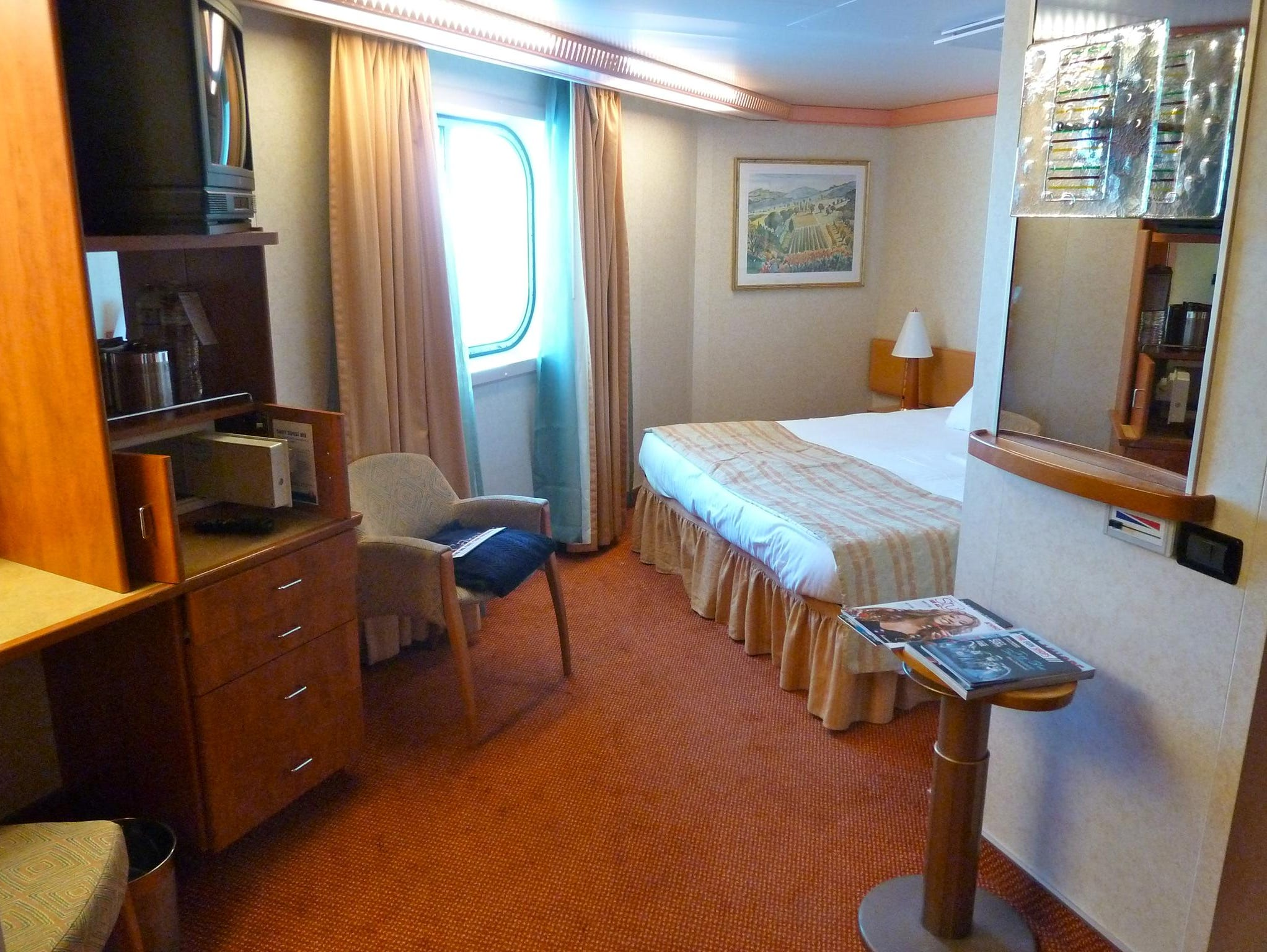 This is one of 327 Ocean View without Balcony staterooms. Equipped for wheelchair access, this particular cabin is located on forward Deck 10 and has an unusual floor plan due to the shape of the ship's superstructure.