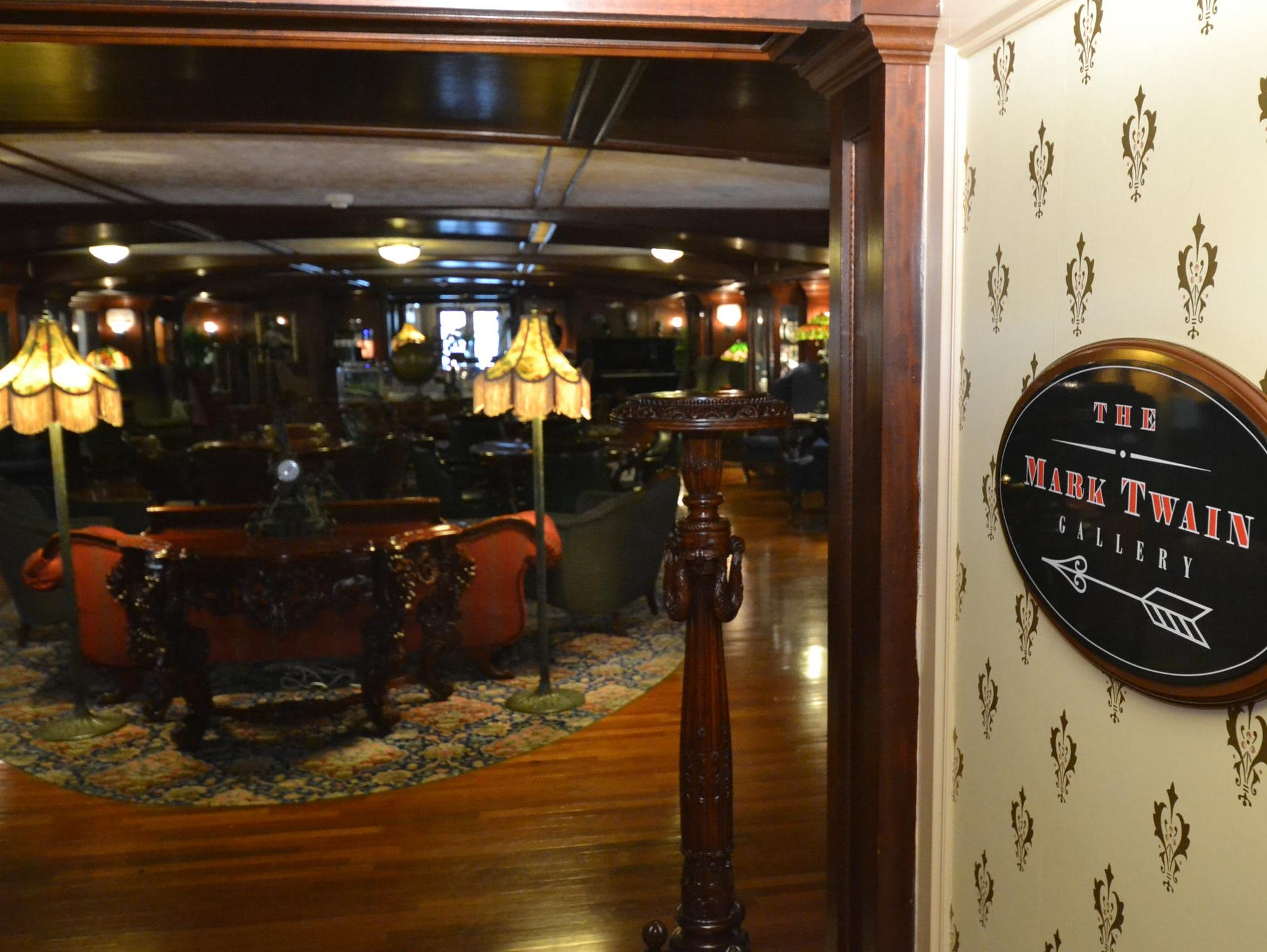 Adorned with rich paneling, crystal chandeliers and period furniture, the Mark Twain Gallery serves as a central gathering point on the American Queen.
