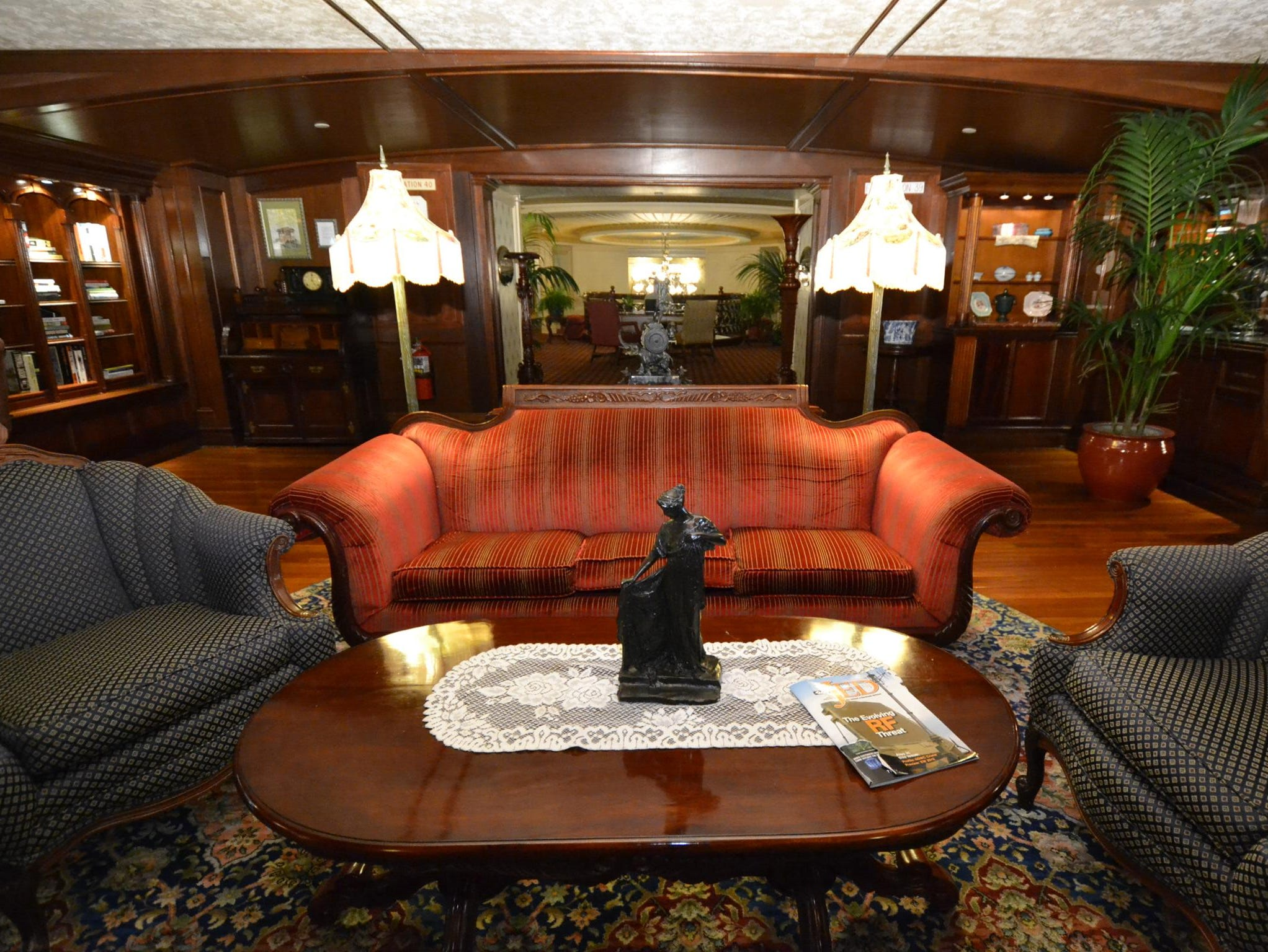 Victorian furniture including sofas, plush armchairs and side tables fill the Mark Twain Gallery.