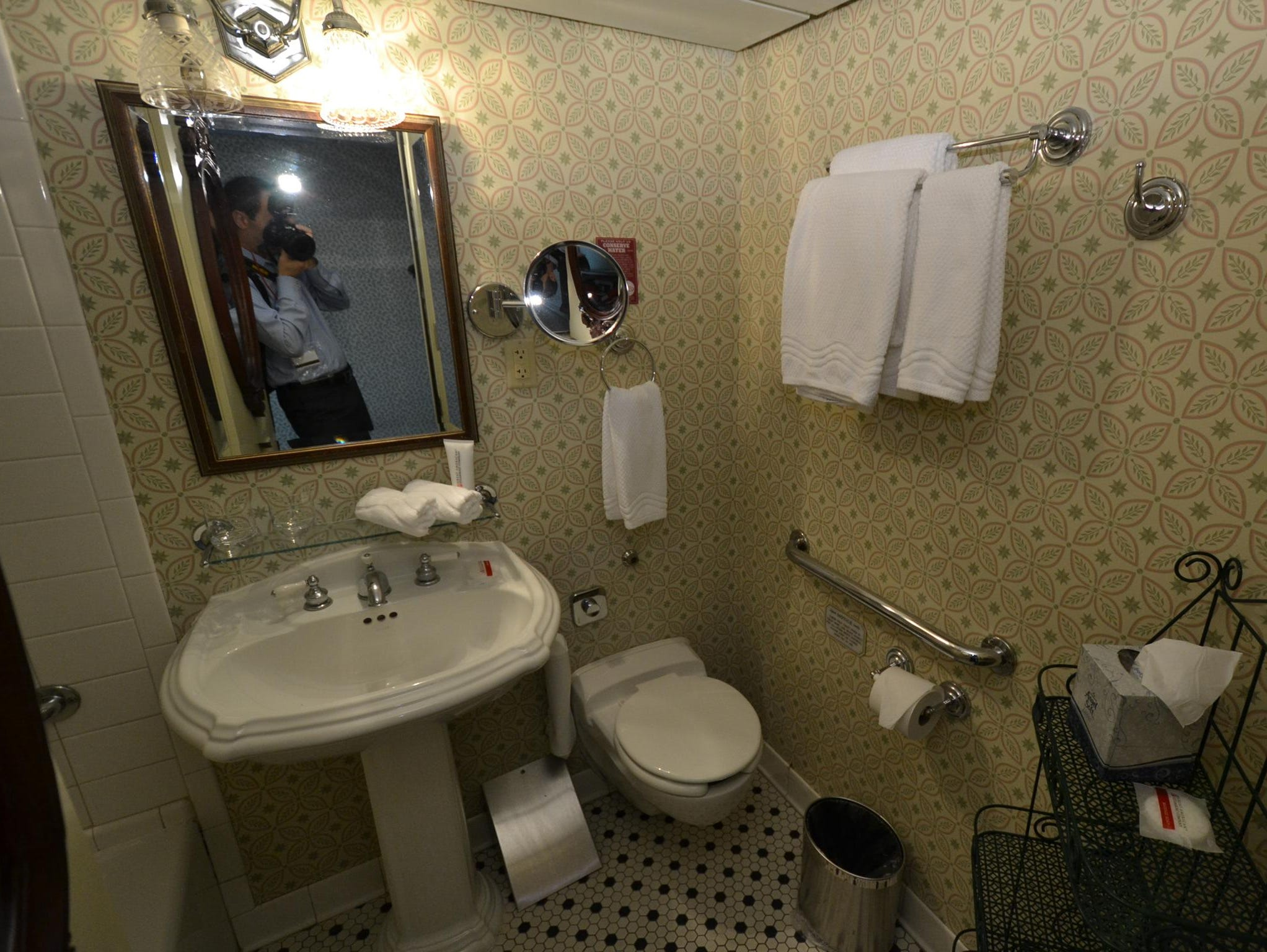 Bathrooms in the Deluxe Outside Stateroom with Veranda category boast a period look.