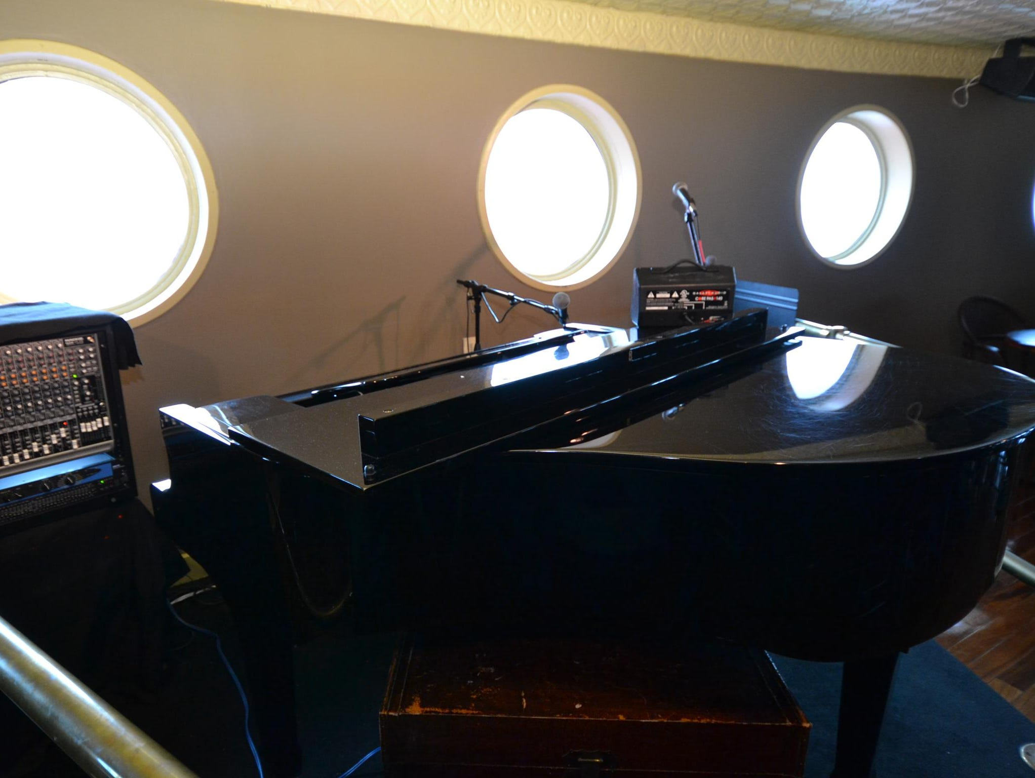 Piano music is a staple of the Engine Room Bar, which has portholes looking out over the American Queen's paddle wheel.