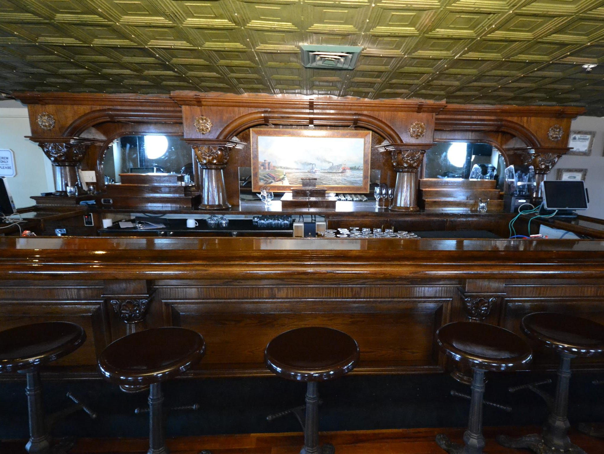The elegant wooden bar at the center of the Engine Room Bar.
