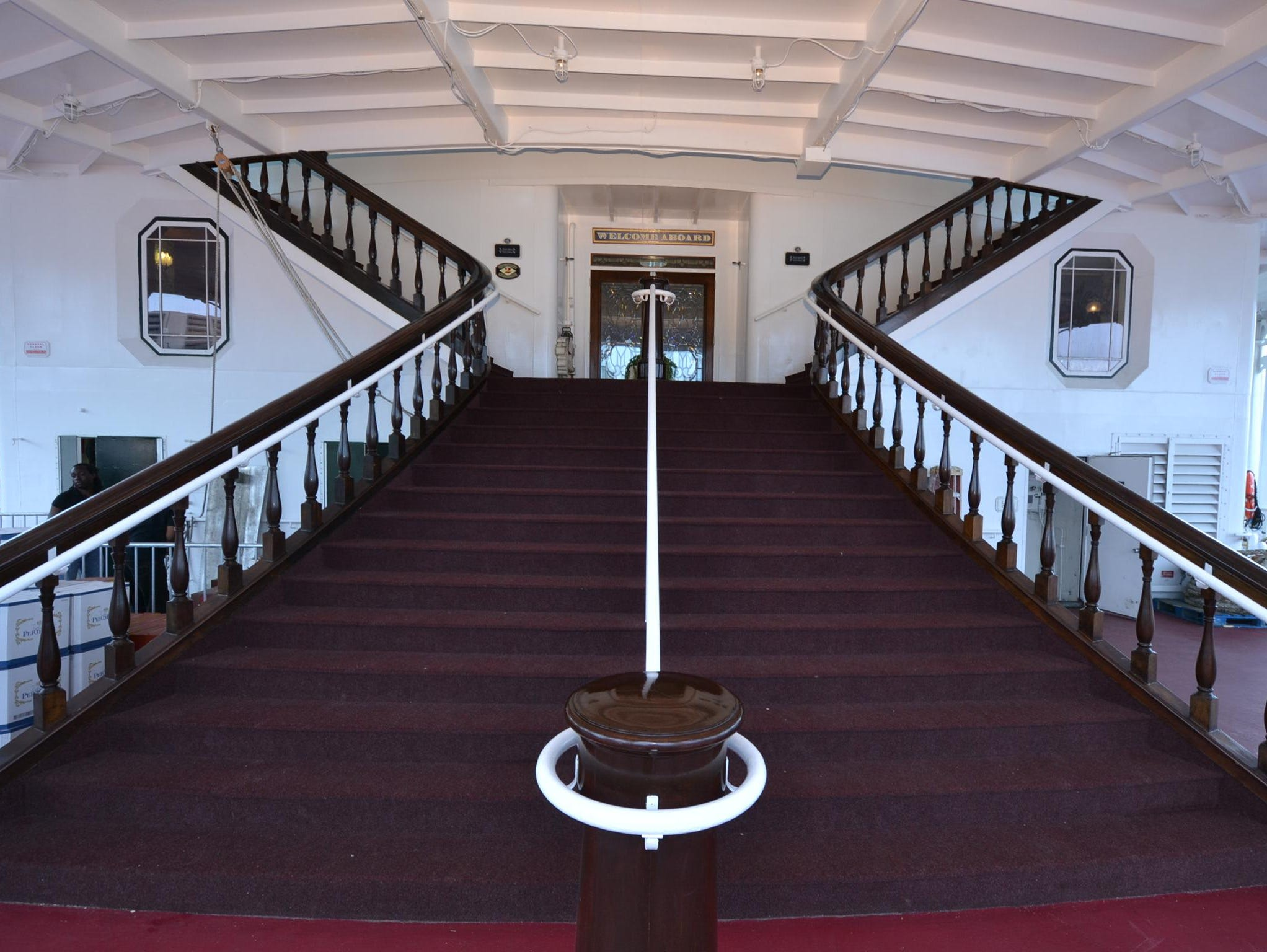 A grand stairway leads up to the main entrance at the front of the American Queen.