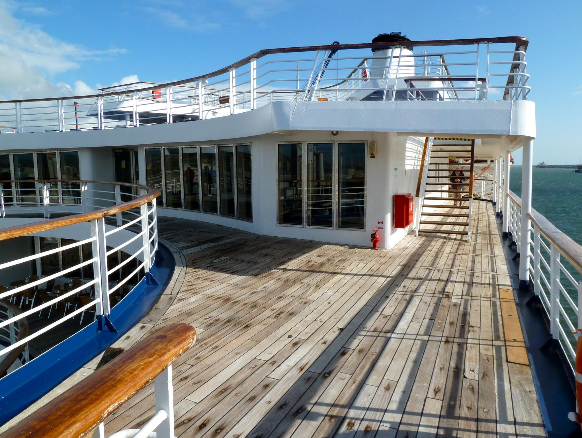 Marco Polo has beautifully-maintained teak decks, as seen here facing forward from the starboard Columbus Deck terrace.