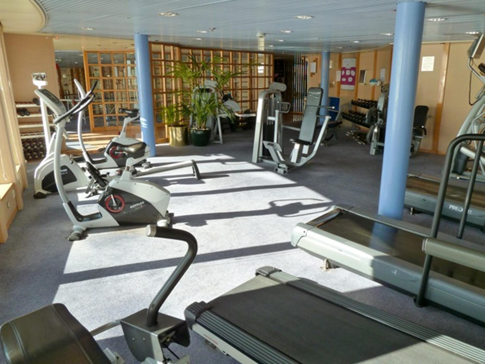 The Marco Polo's gymnasium overlooks the stern from the starboard side of Columbus Deck. Facilities include cardio equipment, weight machines and free weights.