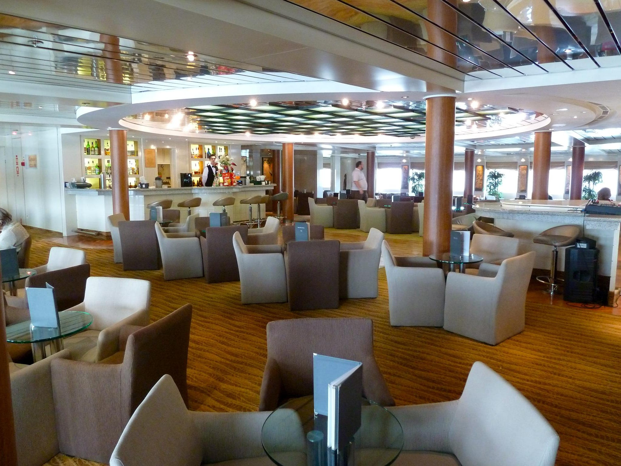 The handsome Captain's Club is an inviting, 220-seat piano bar that spans the width of the ship on Magellan Deck.