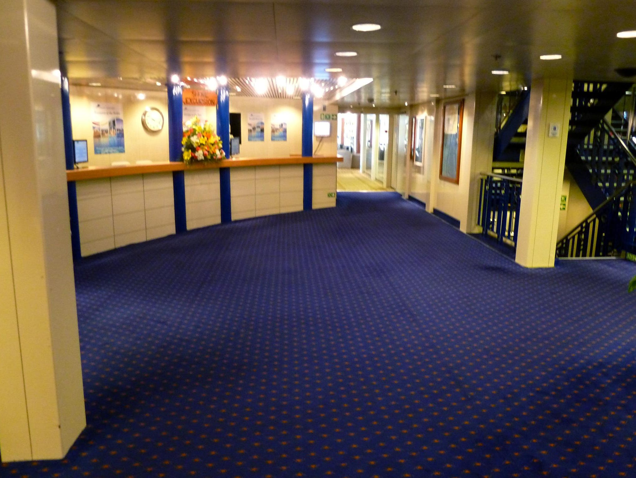 The shore excursions desk is opposite the reception foyer on midships Magellan Deck.