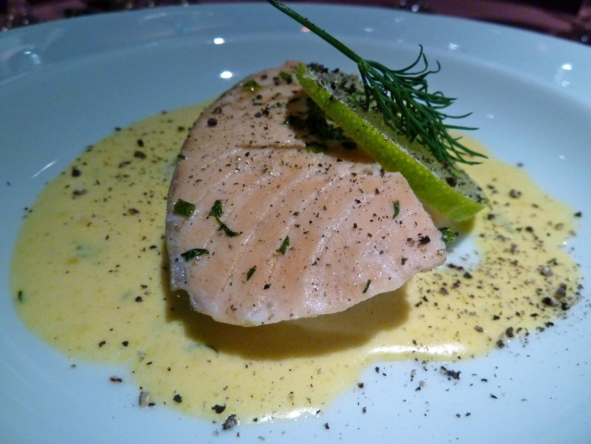Dinners in the Waldorf include a selection of appetizers, soups, salads, entrées and desserts. This is a poached-salmon starter in a creamy dill and lime sauce.