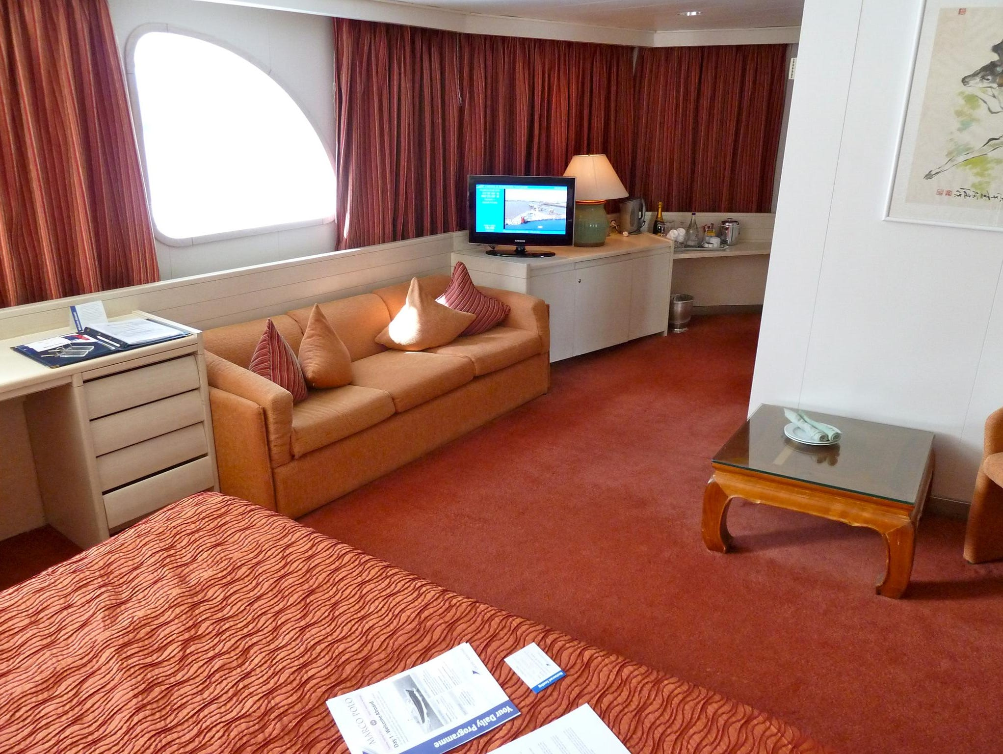 Four 253-square-foot Category JS Junior Suites are located on Pacific and Navigator Decks. These cabins feature two twin or one queen bed, a sitting area and marble bathrooms.