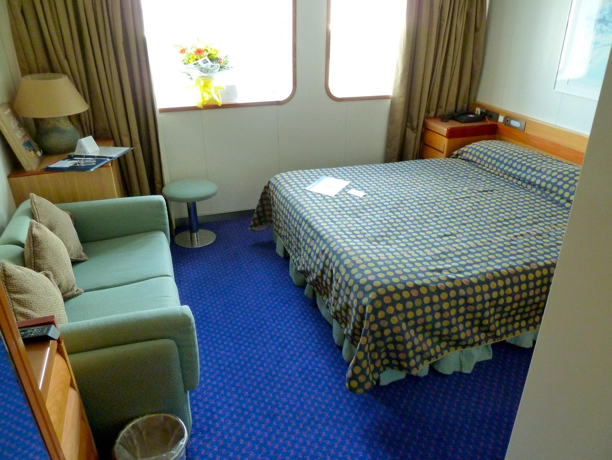 Eight 213-square-foot Category DL Deluxe Cabins have either two twin or one queen bed, picture windows and a bathroom with full bath.