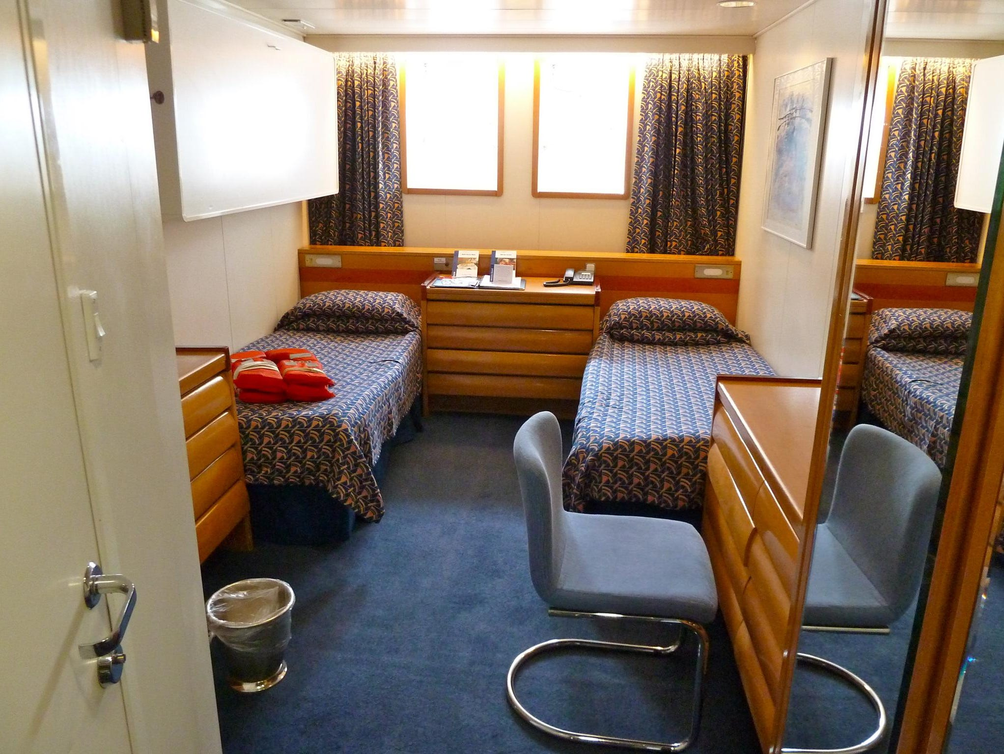 Category 7 Standard Twin Ocean View Cabins measure on average 126 square feet and feature ocean views through one or two portholes. This one has an additional pullman berth.