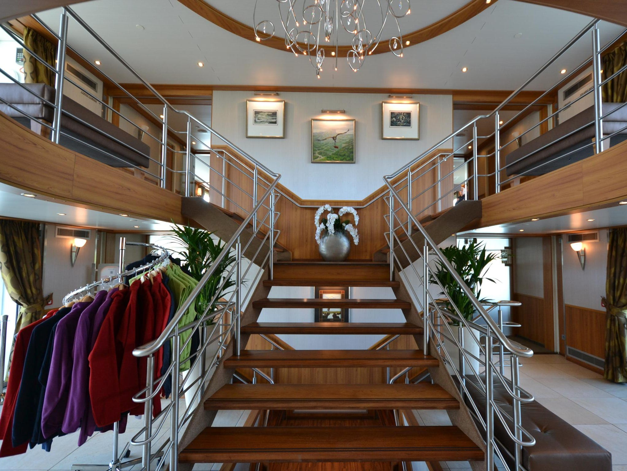 The lobby of the River Discovery II contains a central stairway connecting the vessel's three passenger decks.