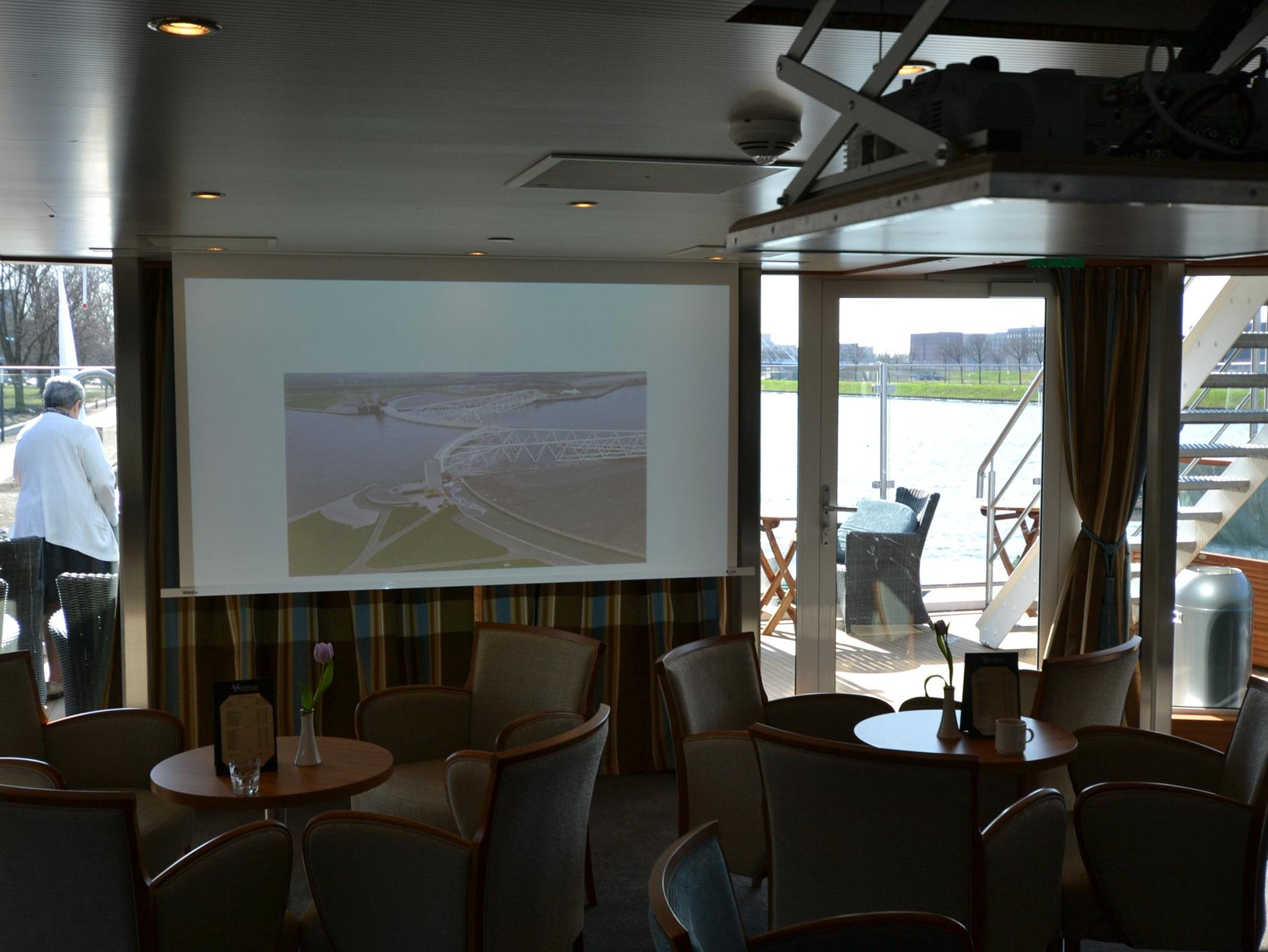 The Latitude 52 Lounge is equipped with pull-down projectors that are used during port lectures and other on-board presentations.