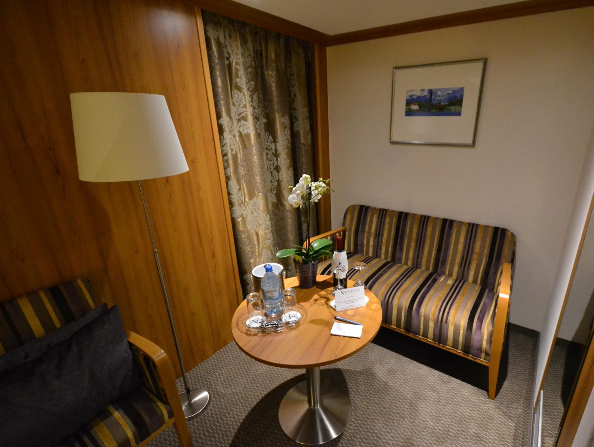 The sitting area in a Deluxe Suite. Deluxe Suites are more than 50% larger than standard cabins on the ship.