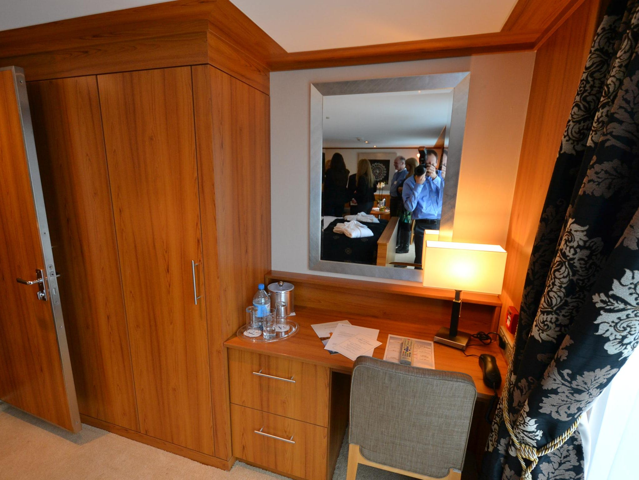 The closet and desk area of the ship's Owner's Suite. Like other cabins on the ship, the suite features a flat-screen television with On Demand video and live streaming of several U.S. cable stations including MSNBC, CNN and Discovery.