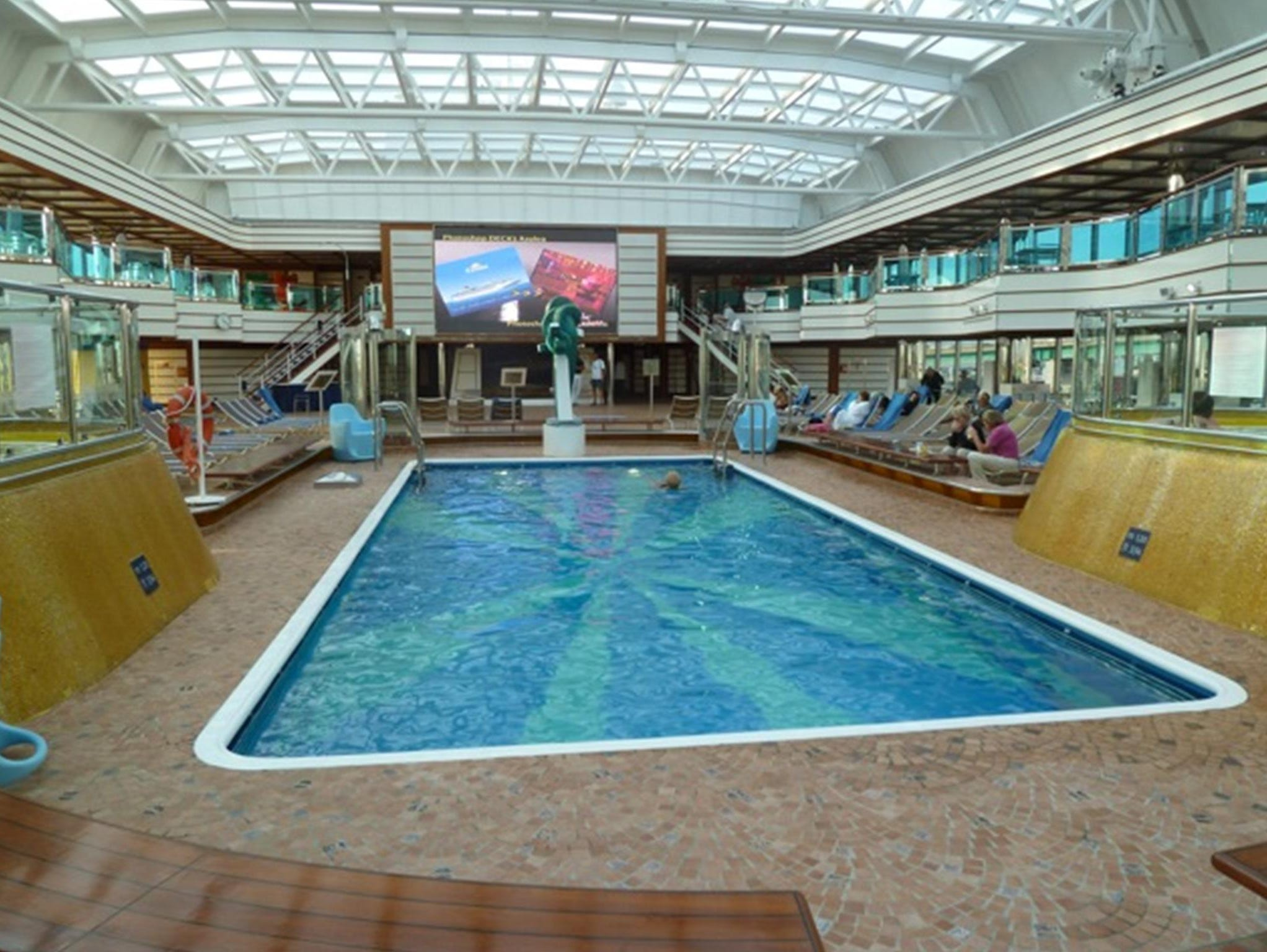 """The """"all weather"""" Lido Azzurro on Orchidea Deck (9) not only is home to the ship's largest pool but also has two Jacuzzis and an oversized LED screen that broadcasts movies, news, videos and sports events."""