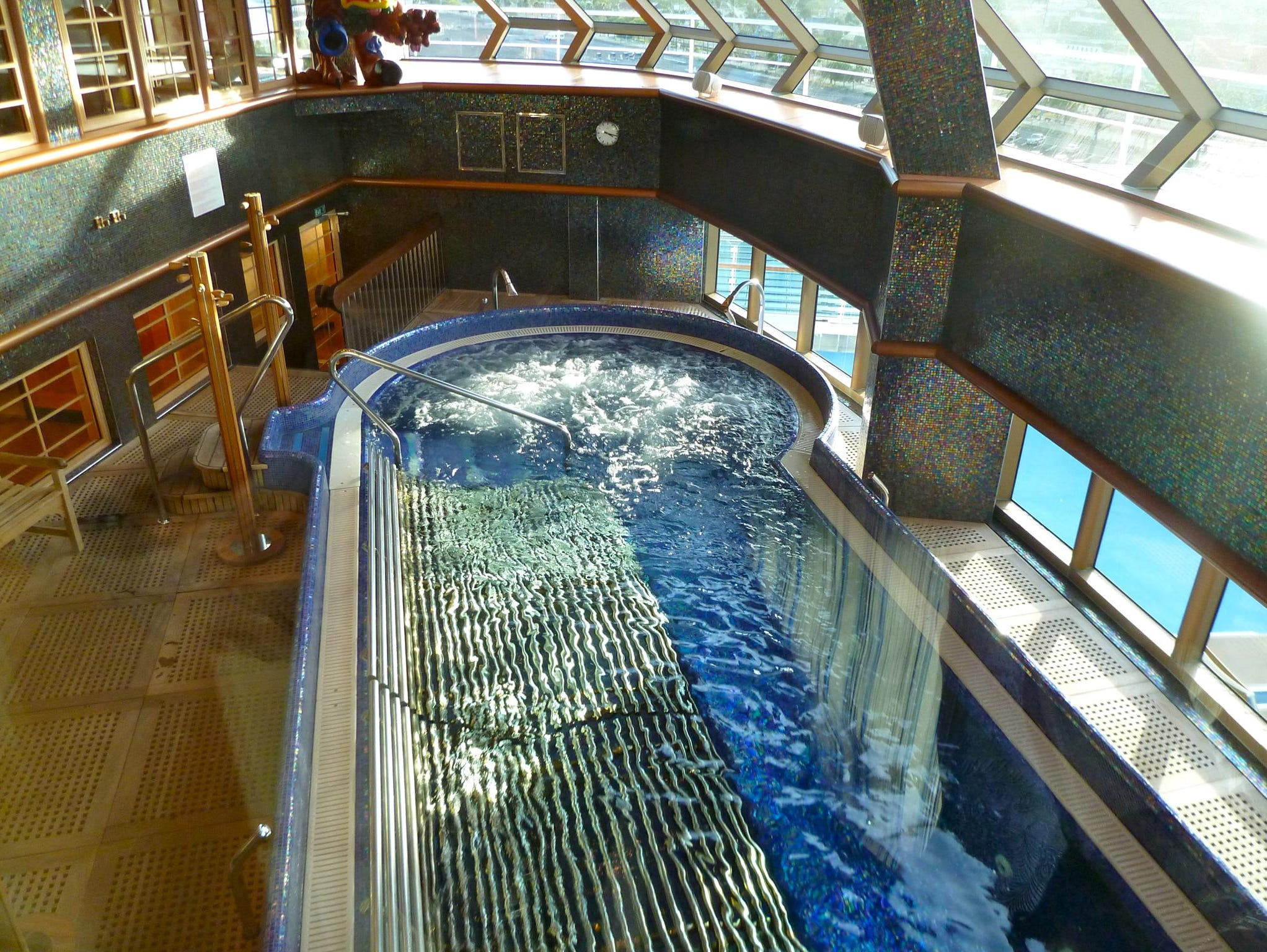 On the starboard side, there is a gymnasium overlooking the bow that also has a port-facing view over the Thalassotherapy pool.