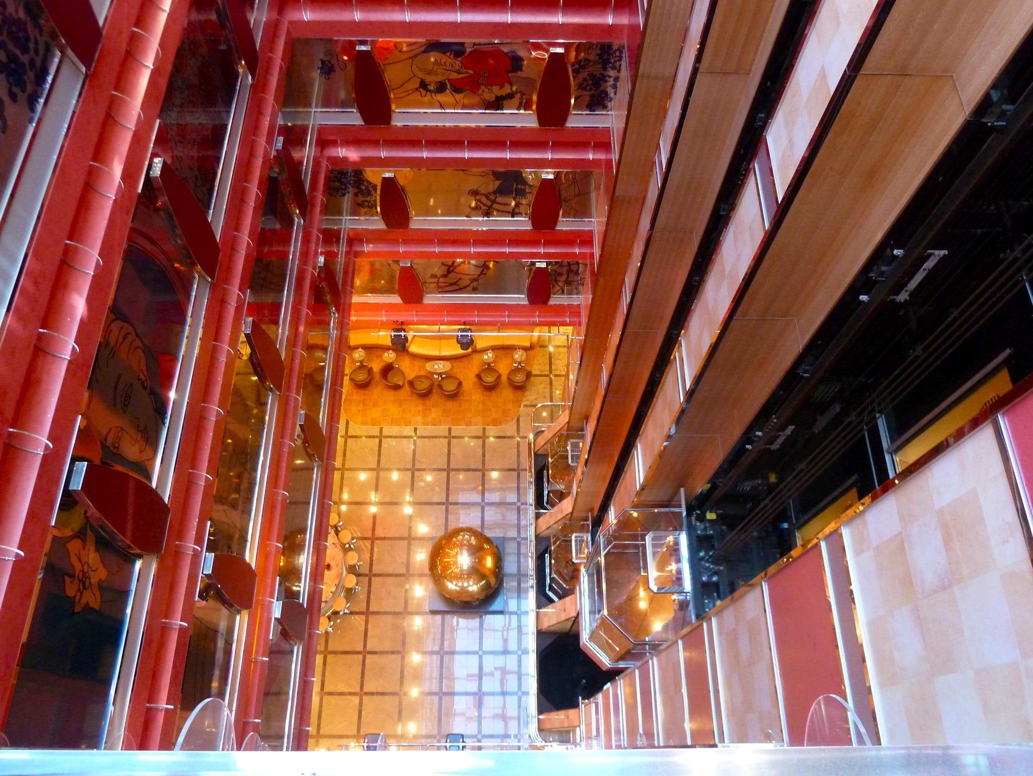 Club Deliziosa overlooks the soaring Atrio delle Delizie, an eight-deck-tall, glass skylight-topped atrium.
