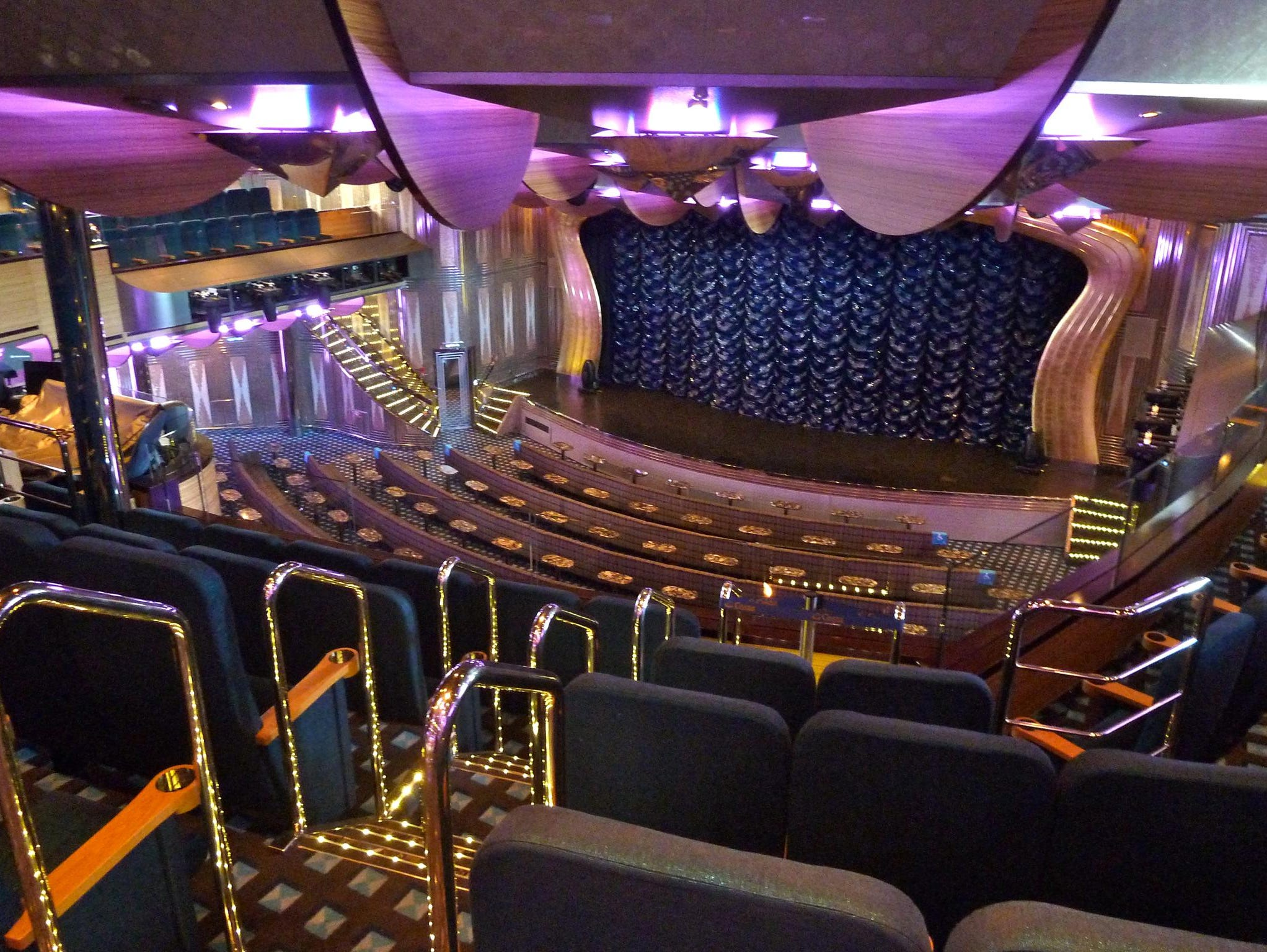 The upper level of the 800-seat, three-deck main show lounge, the Duse Theater, begins the line-up of public rooms on Azalea Deck.