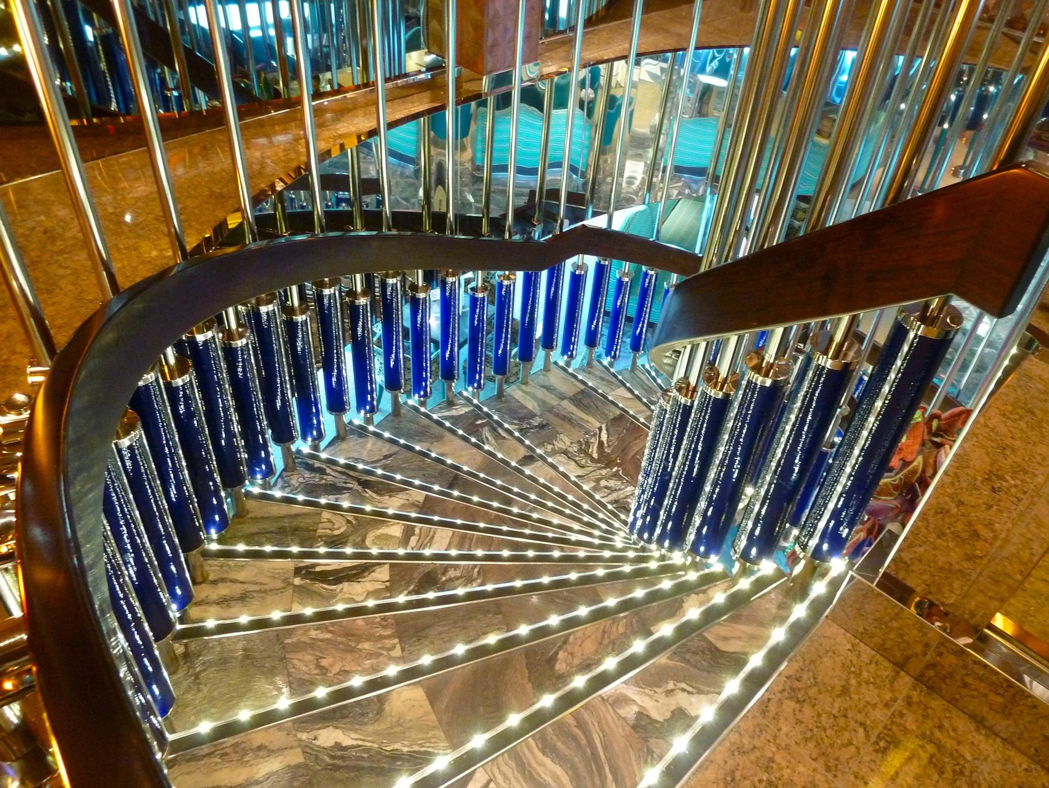 Marble stairs lead from the starboard/forward passage on Azalea Deck down to the public areas on Gardenia Deck.