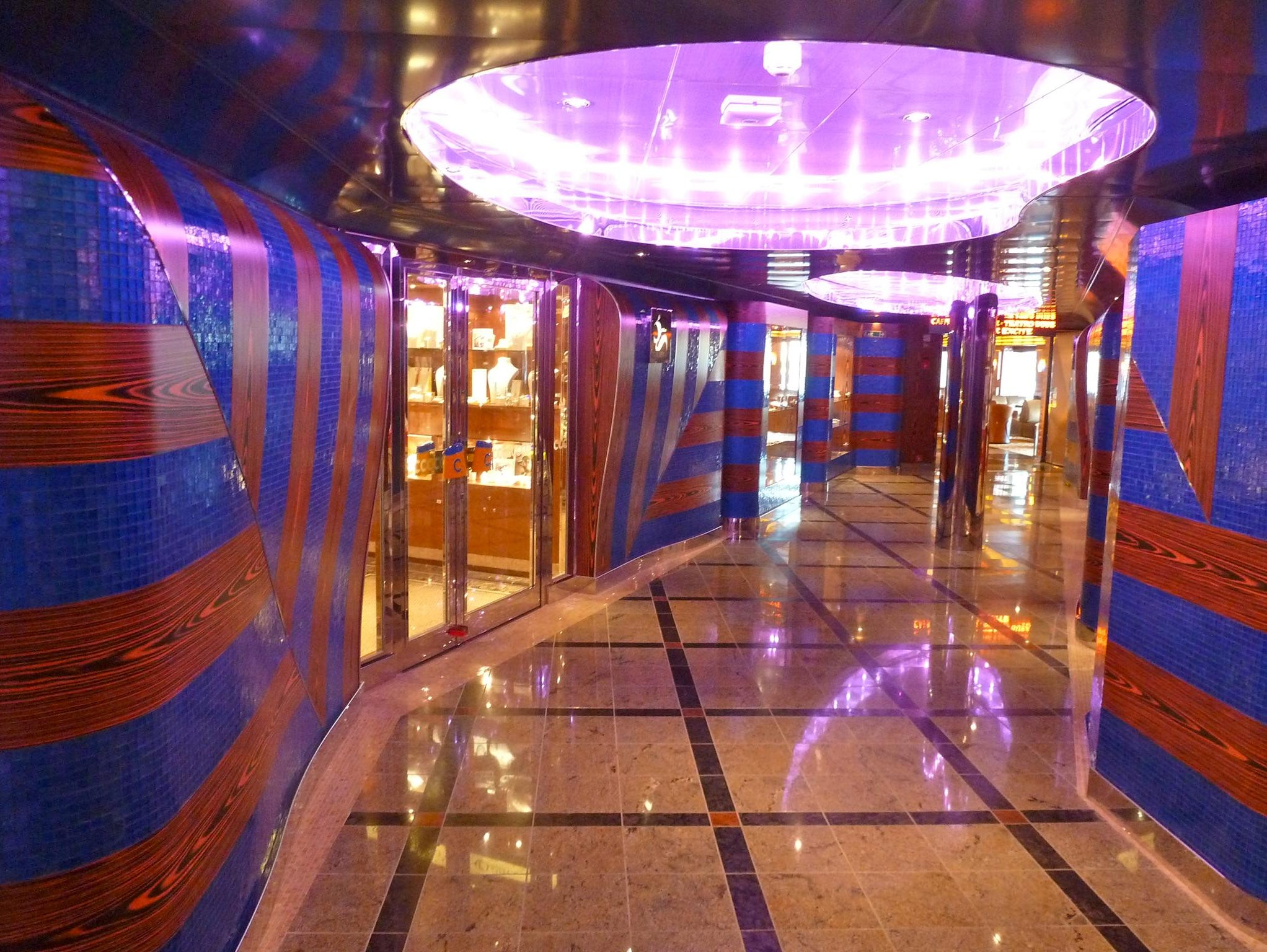 """The Azalea Deck passage winds its way aft through the Galleria shopping area. Note the """"mod"""" ceiling recesses, not unlike those found aboard post-war Italian liners."""