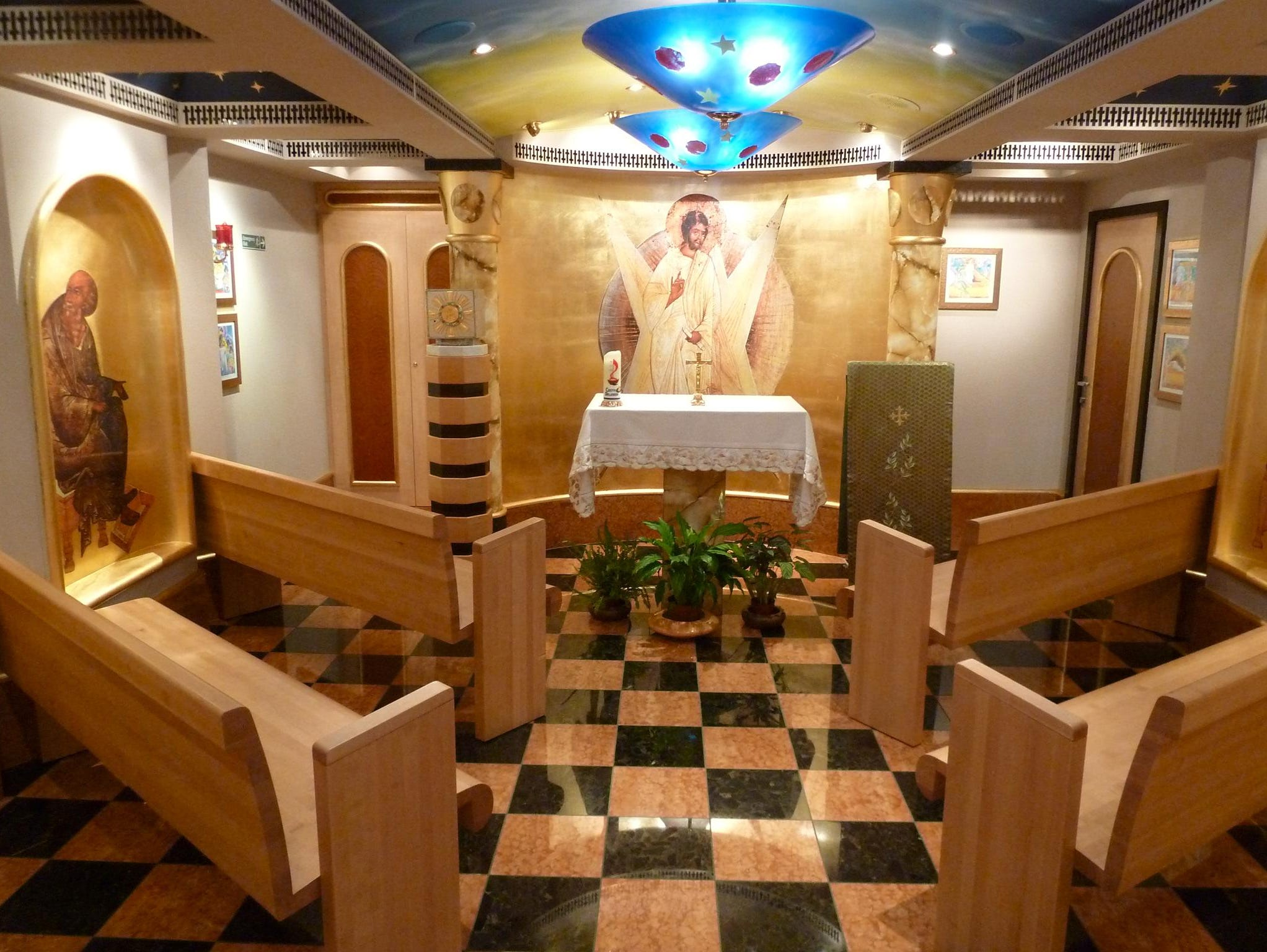 The Chapel is a splendidly appointed space that harkens to an era when all Italian liners had a chapel. It features warm wood tones, checkerboard marble, gold leaf and blue Murano glass.