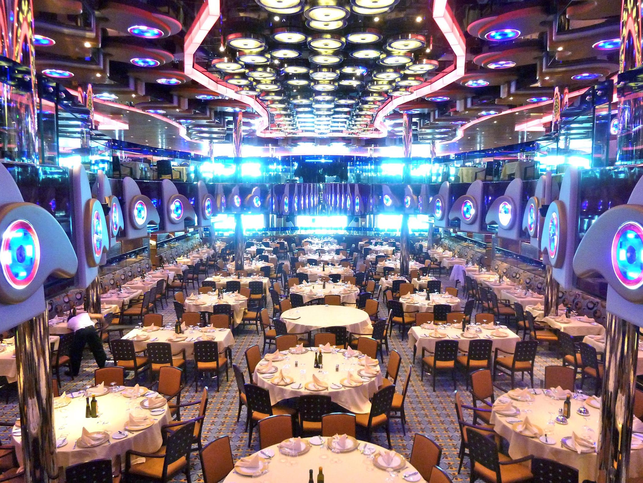 Concluding Azalea Deck, the Restaurant Albatros is the Costa Deliziosa's main dining venue. The upper level is a balcony with a large central opening that is bridged by a musician's stage.