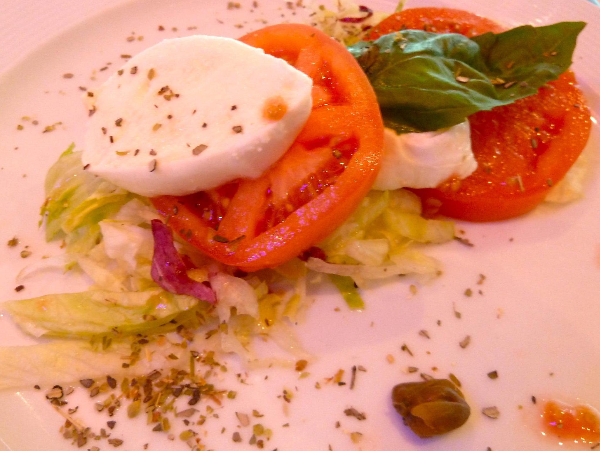Salads include insalata Caprese with buffalo mozzarella, fresh basil, capers and oregano.