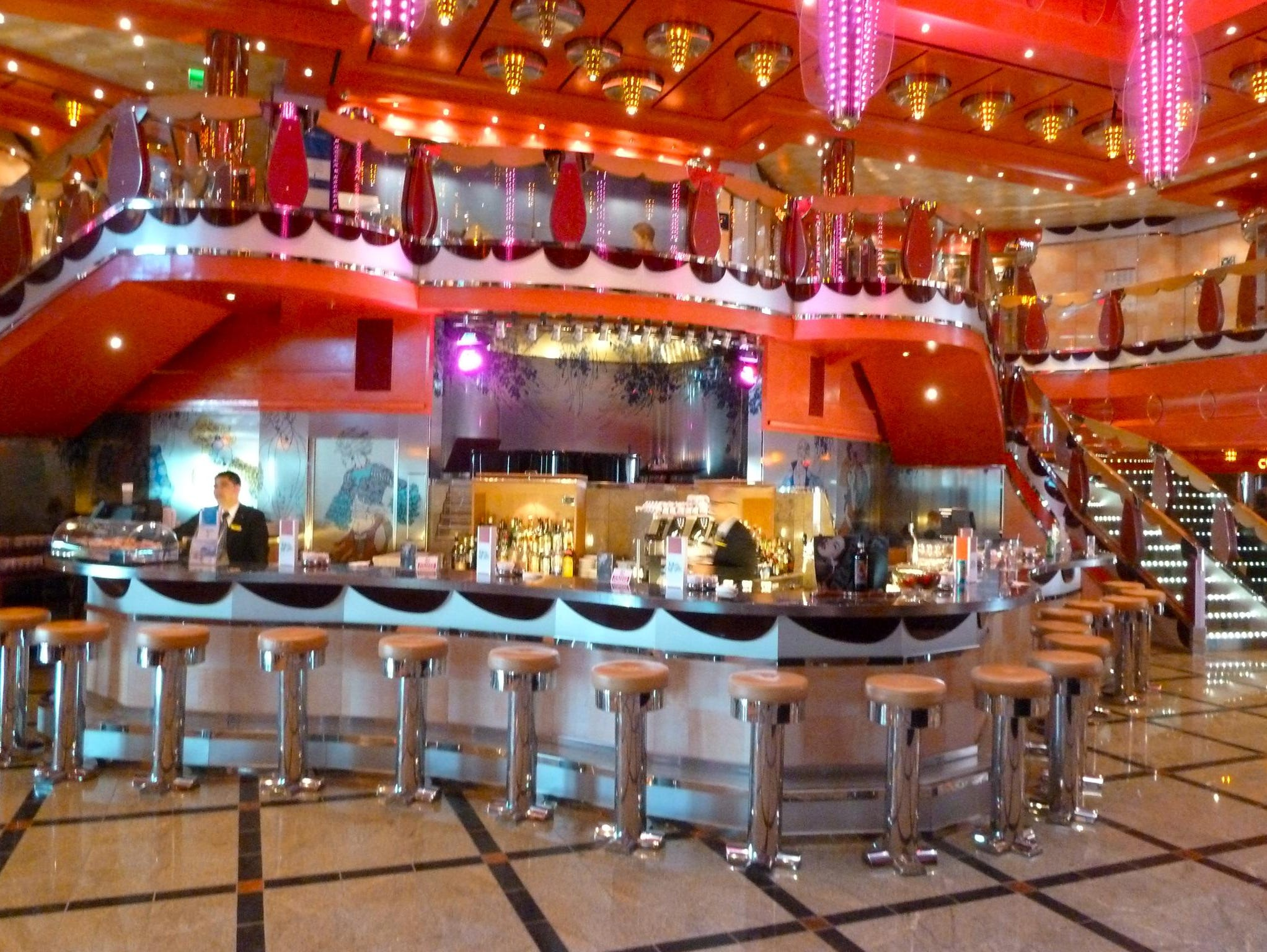 At the foot of the Atrio delle Delizie's eight-deck lobby and trio of panoramic elevators is the festive Bar delle Delizie.