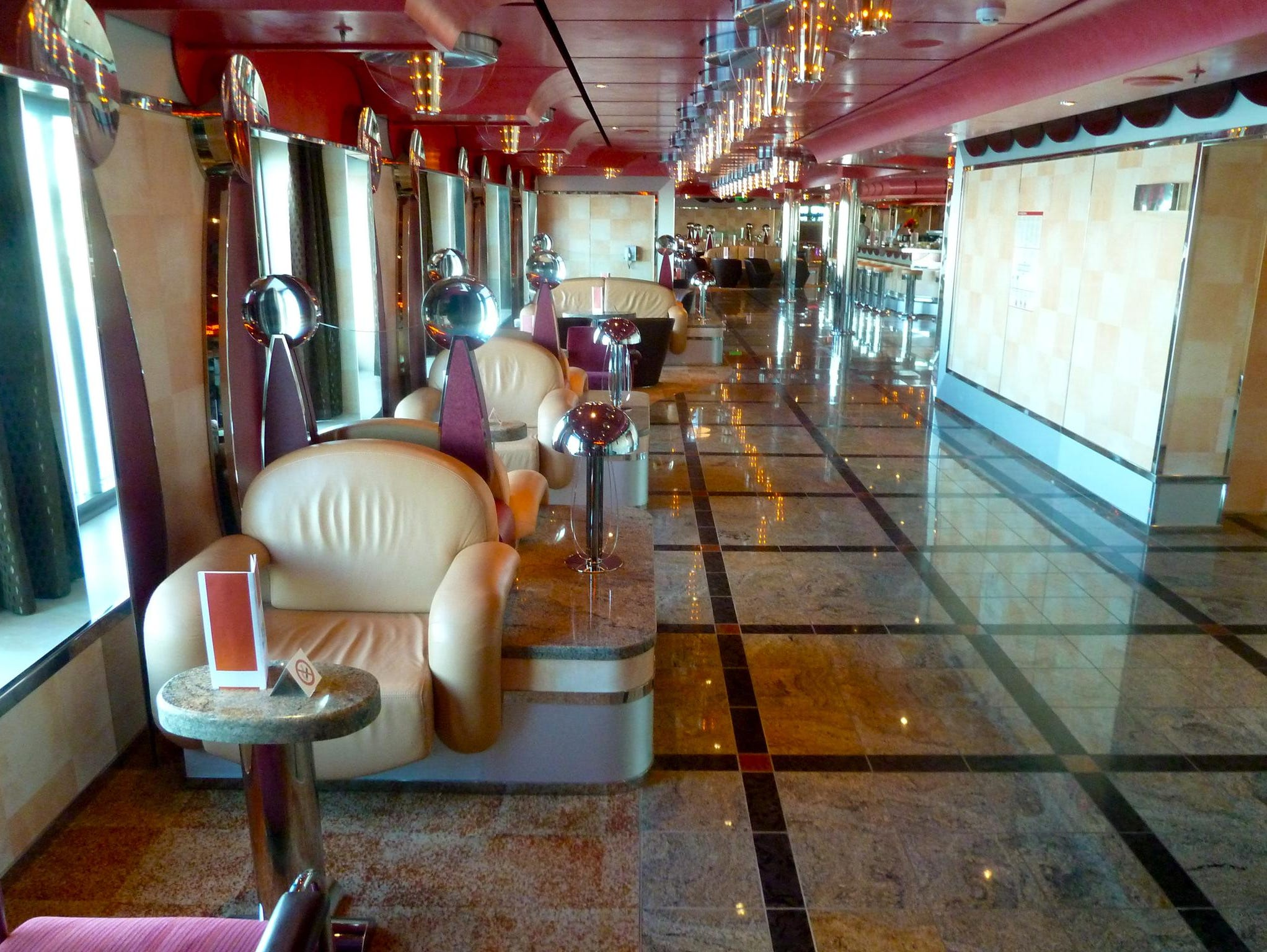 The Gardenia Deck passage continues aft on the starboard side with the Lounge and Bar Alcazar (shown facing aft), another bar that is a favored gathering spot for pre- and post-dinner drinks.