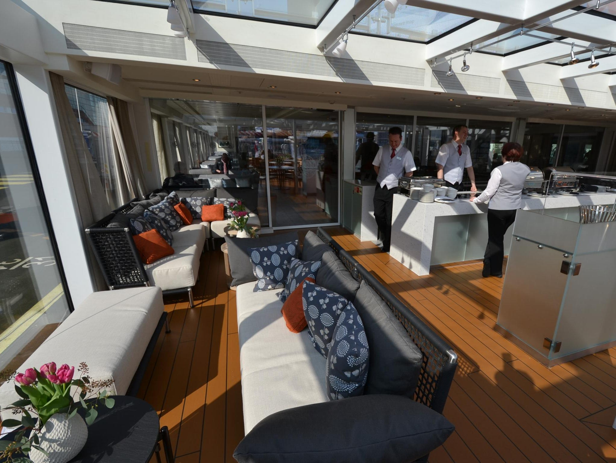 Made possible by a new, patented bow design, the wide-open Aquavit Terrace is home to a buffet area where light lunches can be served to passengers as the ship sails.