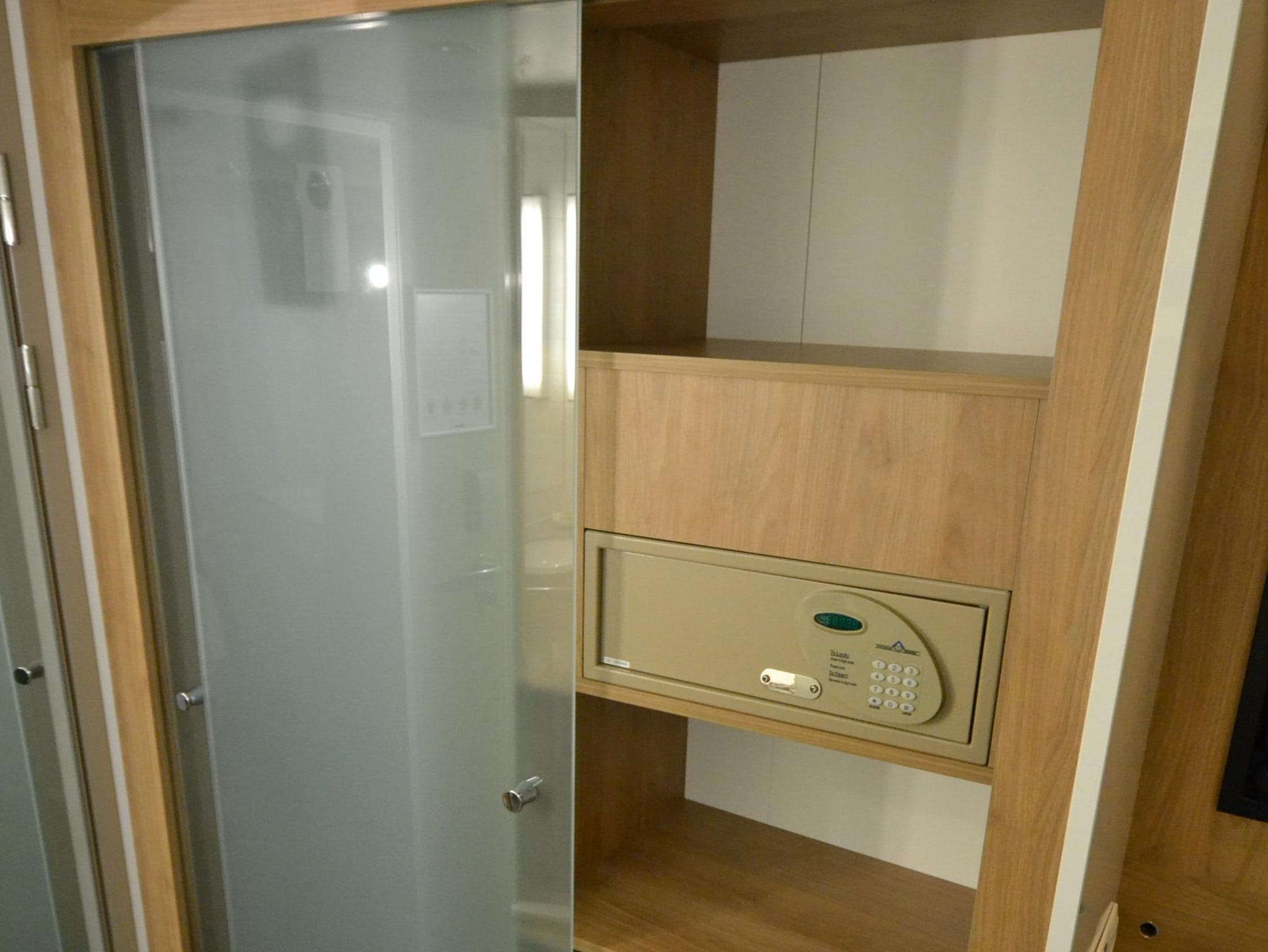 French Balcony Staterooms have wide built-in wardrobes with translucent glass doors that feature shelving and a safe on one side and space for hanging clothes on the other side.