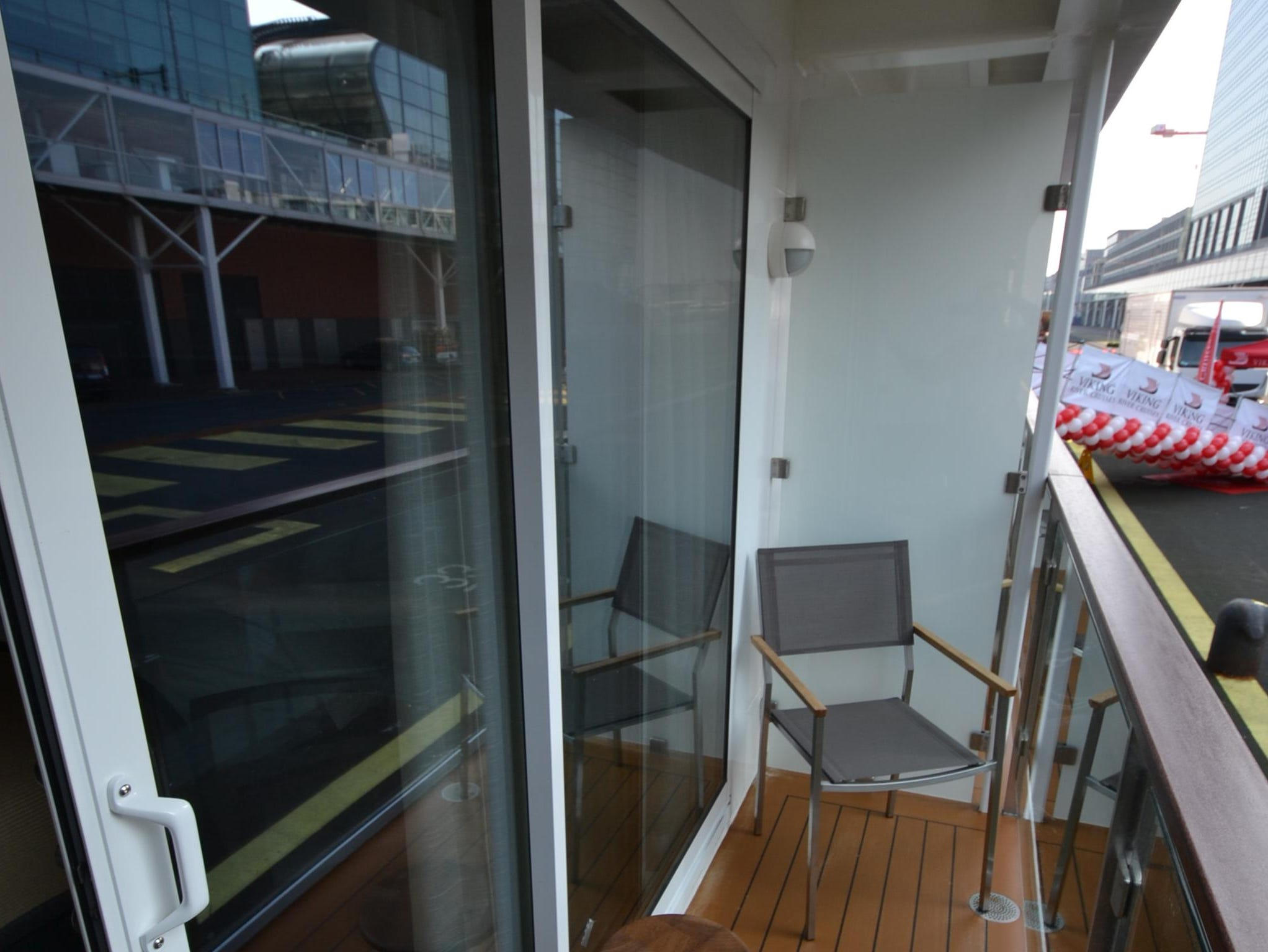 Dubbed Veranda Staterooms, the balcony cabins have a balcony big enough for two chairs and a small wooden table.