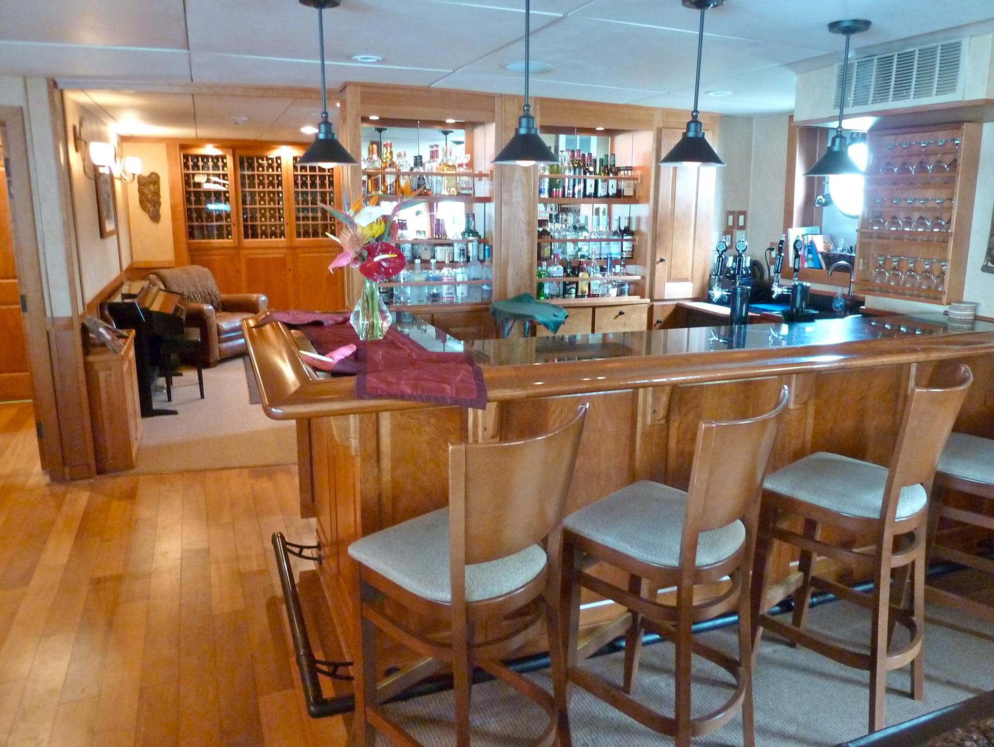 The bar is stocked with top-shelf liquors and soft drinks as well as on-tap beers. Should a bartender not be available, guests have full access to serve themselves.