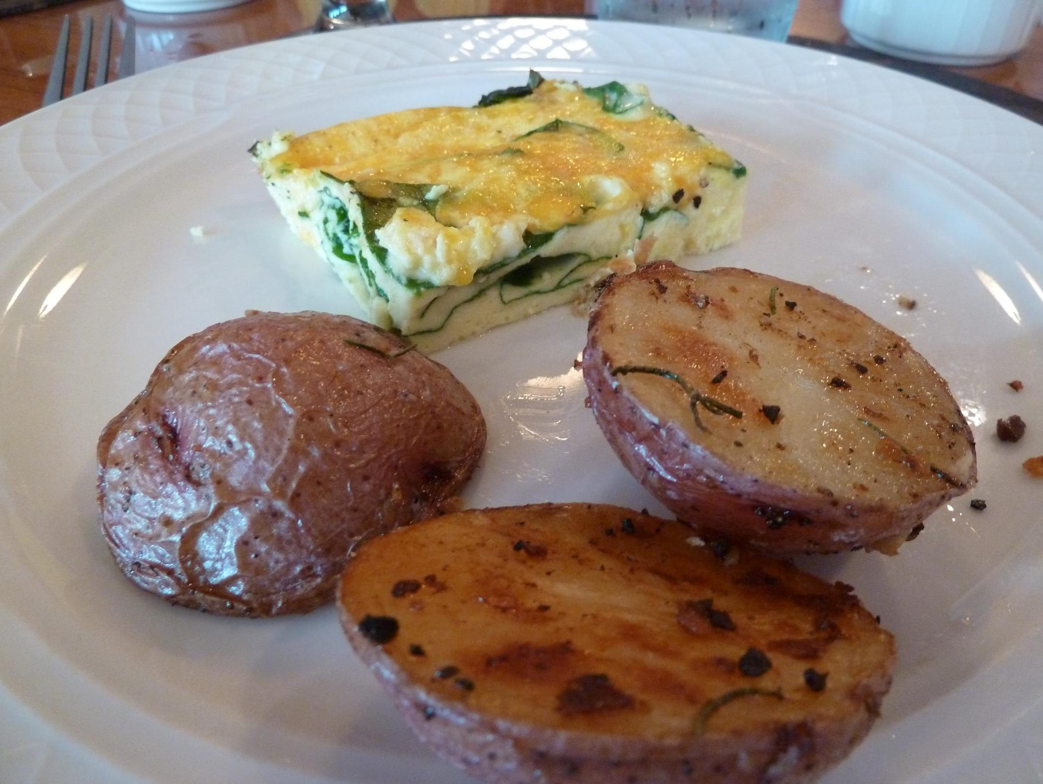 Every day begins with a new breakfast special, from French toast and banana pancakes to this spinach and cheddar frittata or eggs prepared to order. Breakfast also includes olive oil and rosemary potatoes, bacon and sausage.