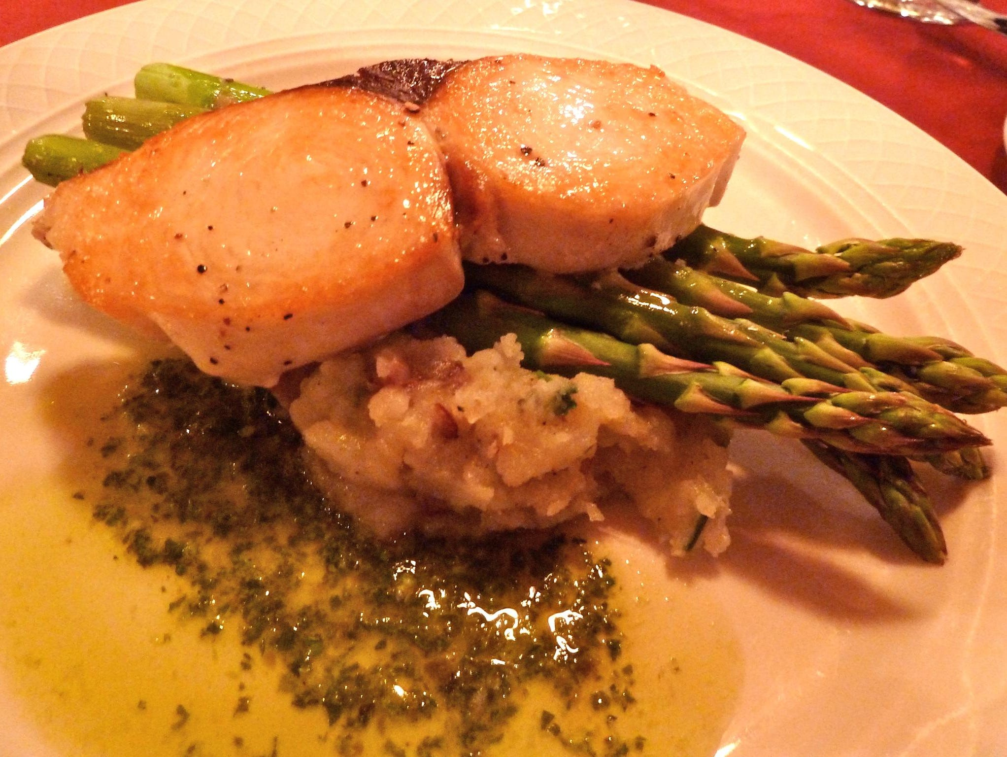 Dinner entrées are either a meat or local fish selection, such as this Hawaiian Ono fish cooked in olive oil and sea salt with asparagus, garlic mashed potatoes and pesto sauce. Vegetarian alternatives are available for all meals.