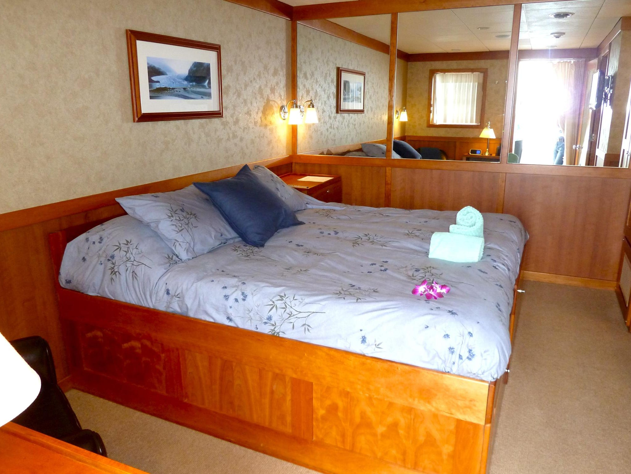 Two Commander Staterooms are fitted with a king-sized bed and have slightly more space than the next lowest tier, the Master Staterooms. There is also a nook with sink as well as a separate bathroom with toilet and shower.