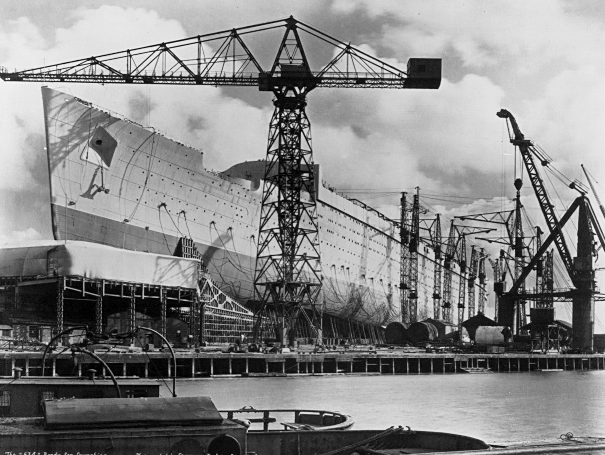 '534' sat on the stocks for over two years until a government loan contingent on the merger of struggling rivals Cunard and White Star Lines was granted. Many decried the loan as wasteful but the ship would eventually more than earn its keep.