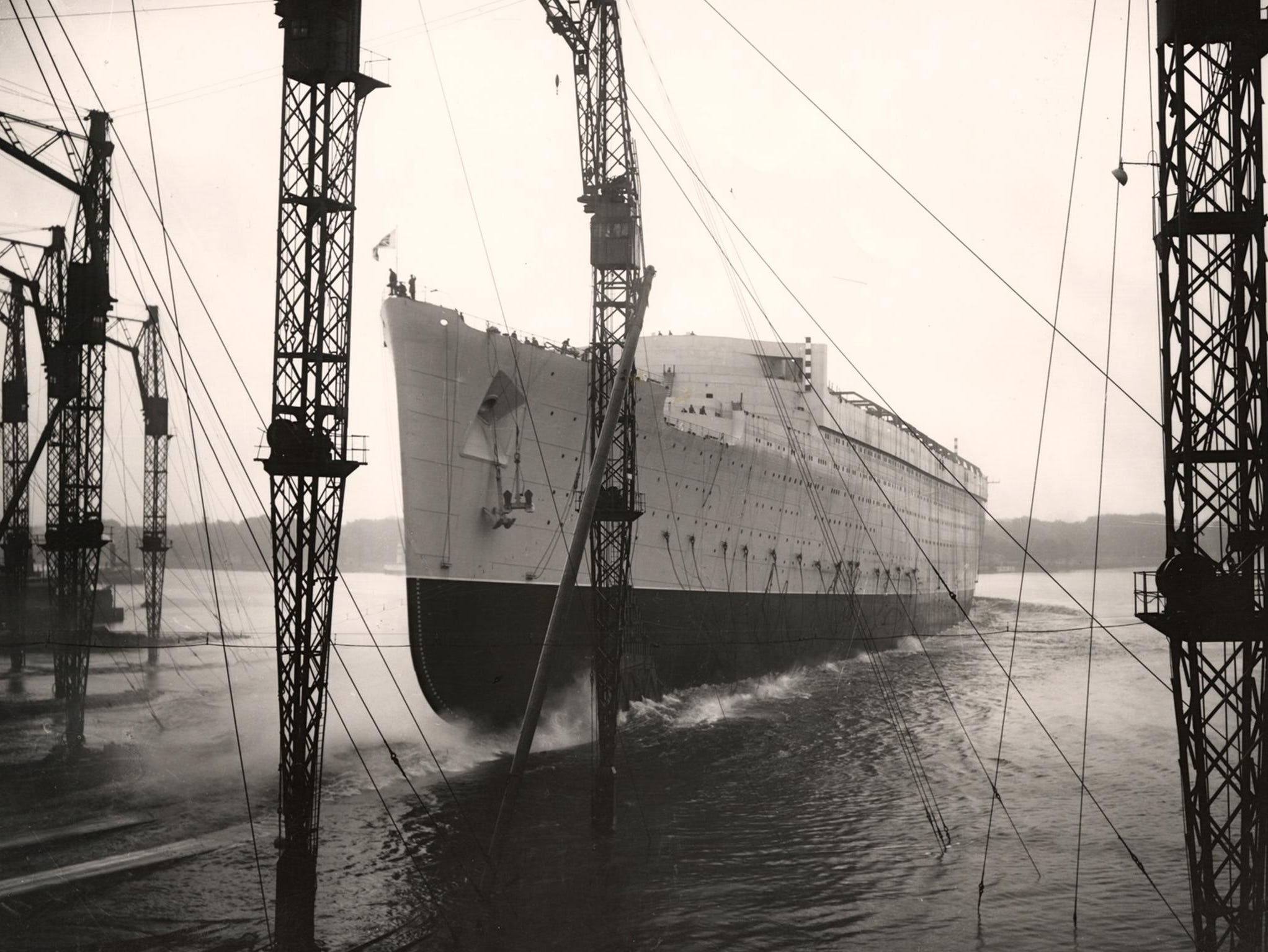 On September 26, 1934, the ship was launched by namesake, HRH Queen Mary, who sent a bottle of Australian wine slamming into its hull. Thousands braved torrential rain to watch as the giant liner slid into the River Clyde.