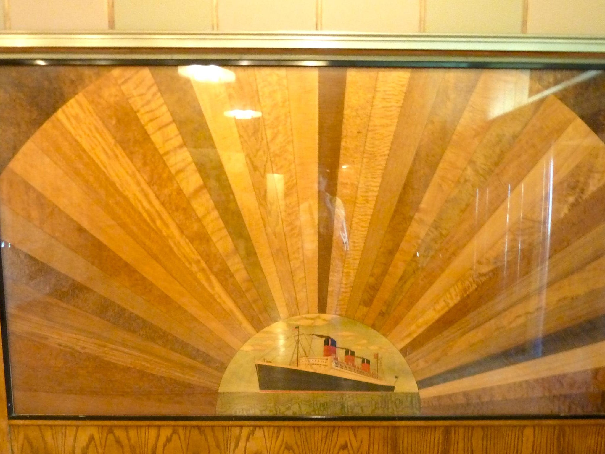 This exquisite marquetry panel shows some of the exotic and now rare woodwork featured on the Queen Mary.