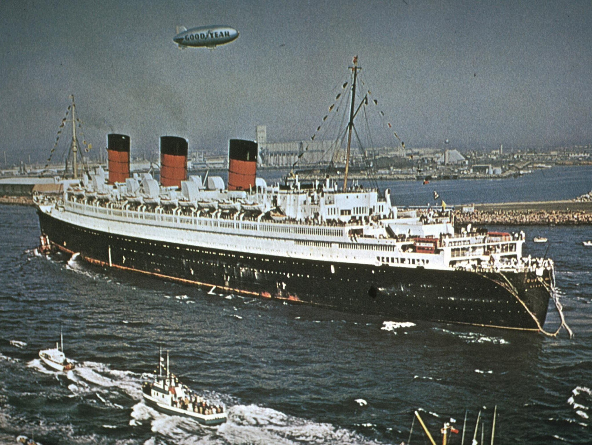 In December 1967, the Mary triumphantly arrived in Long Beach with a 310-foot pay-off pennant flying overhead and four London double-decker buses on the aft decks.