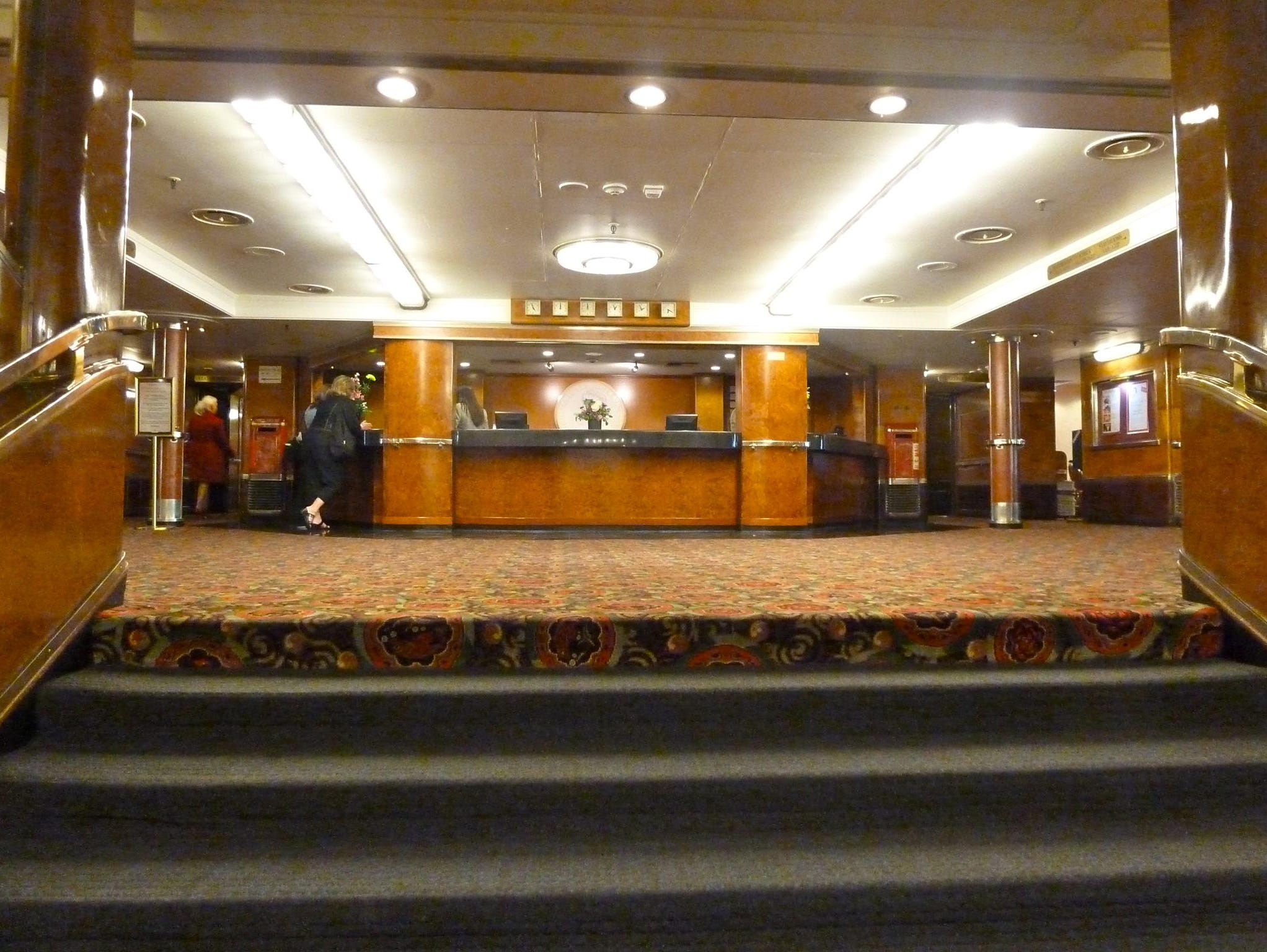 The Queen Mary Hotel Lobby and front desk is accessed from ground level by taking the elevator to level 3. This is the former first-class embarkation lobby.