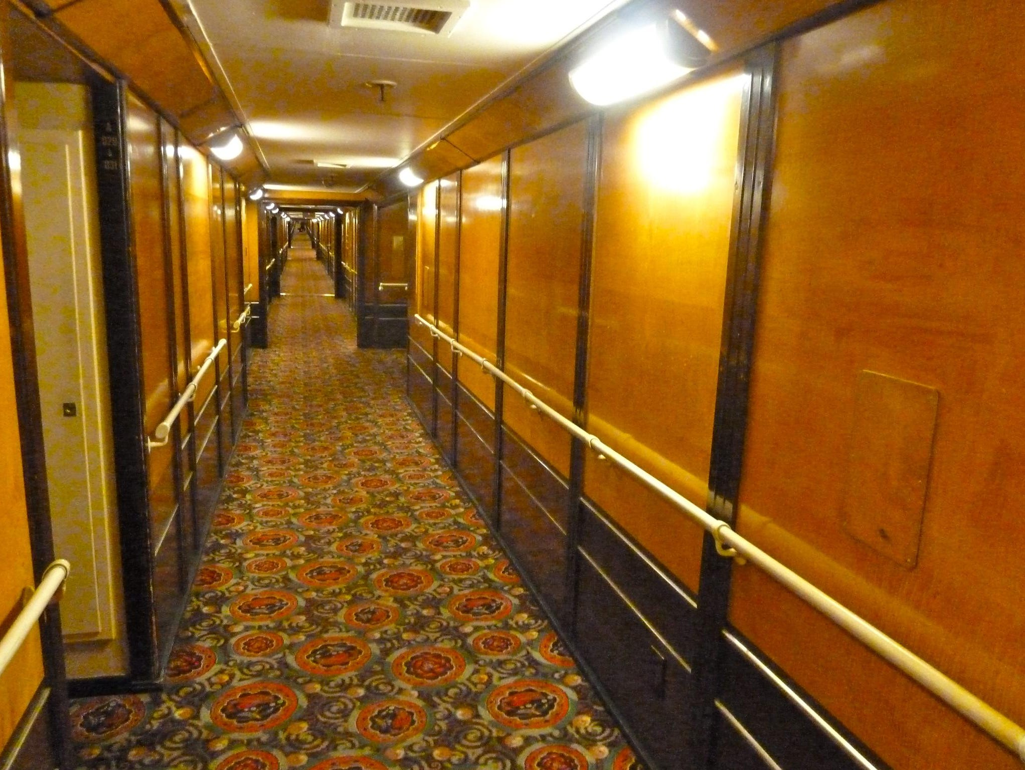Passageways in the Queen Mary Hotel feature exquisitely-polished burled maple and mahogany woodwork.