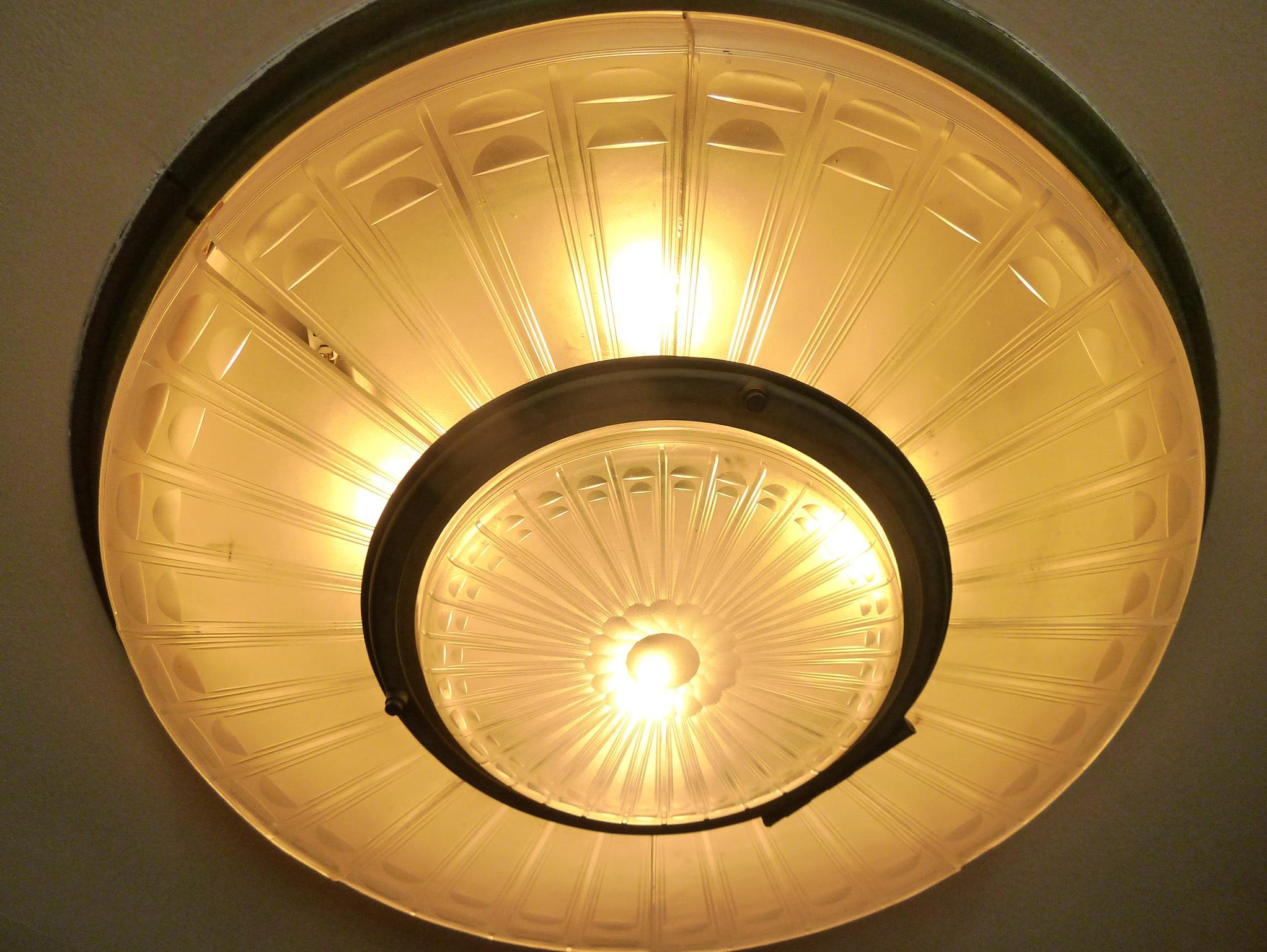 Here is a close-up view of one of those opulent etched-glass light fixtures in the R Deck vestibule.