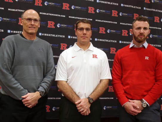 Coaches from the Rutgers football team gather Rutgers