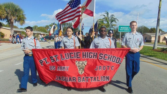 The Port St. Lucie High School Jaguar Battalion marches in the Fort Pierce MLK Day parade. Leading the way are (from left) Cadet Staff Sgt. Victor Alvarez, Cadet Pvt. Michaela Luyao, Cadet Cpl. Andre Hannon and Cadet Pvt. Cameron Lennard.