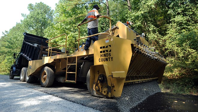 This is a file photo of a Hinds County Public Works Department paving crew.