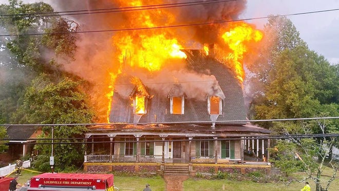 The Little House in Louisville was consumed by flames Monday afternoon after a thunderstorm knocked out powers and downed trees across town.