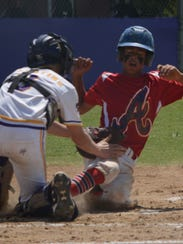 Wylie Junior League catcher Balin Valentine tags out